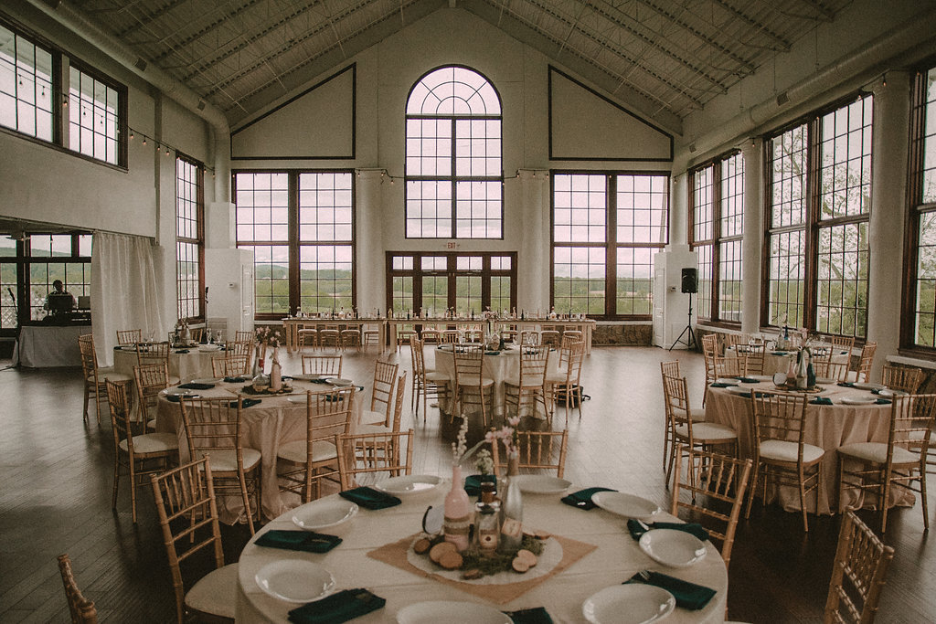 Tables at wedding reception with windows