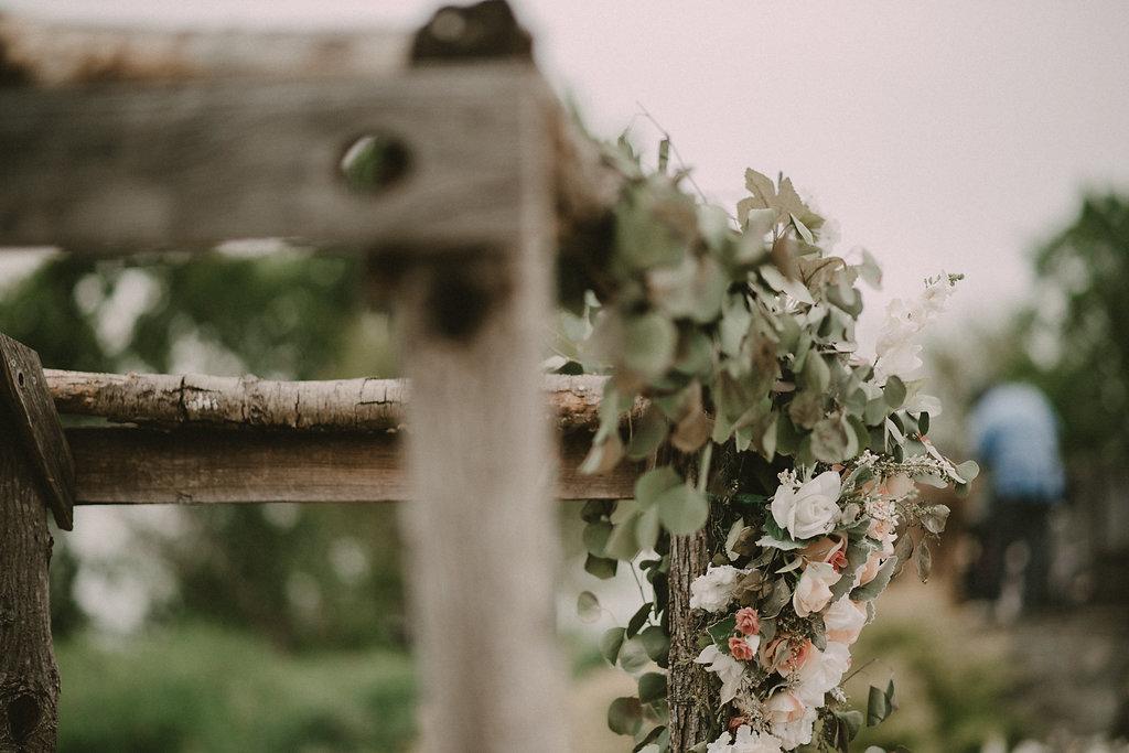 greenery on rustic wedding arbor photo