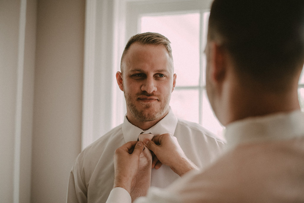 groom and best man  getting ready photo