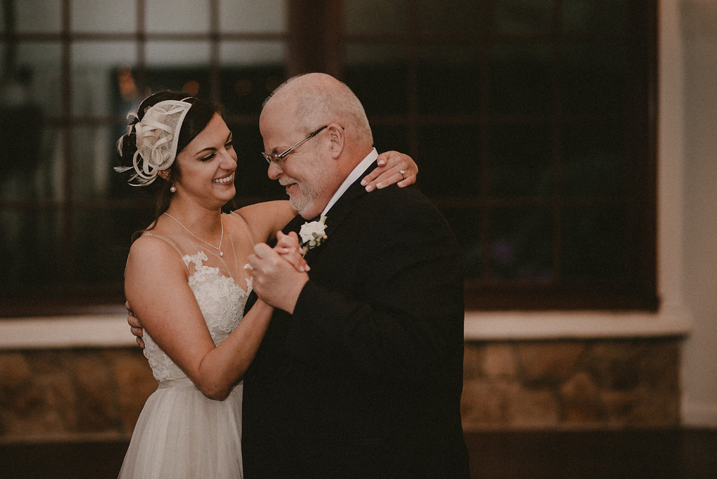 Father and daughter dance at reception