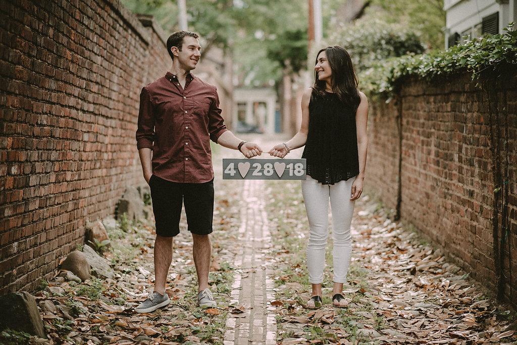 Couple walking down cobblestone street