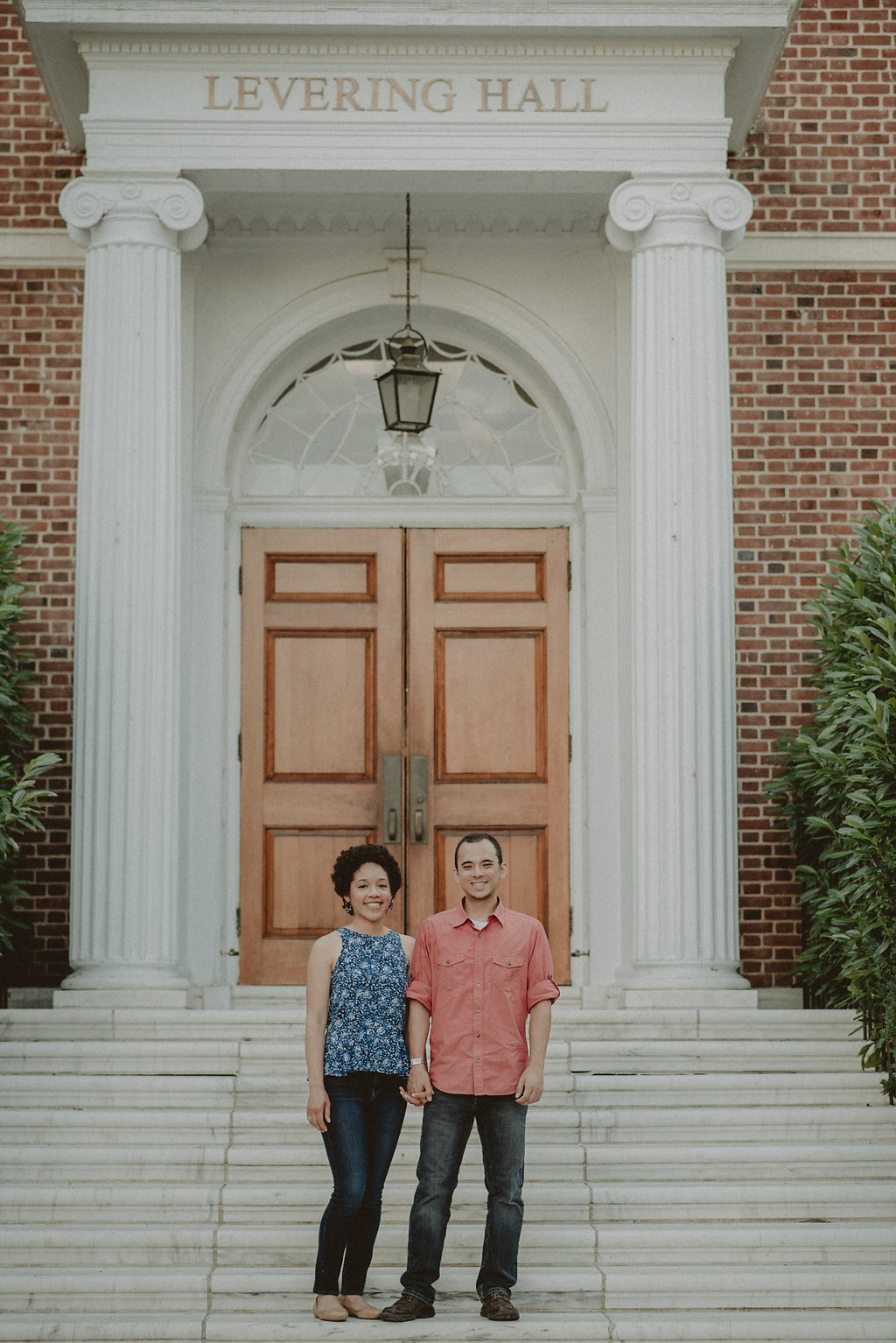 Couple holding hands on steps