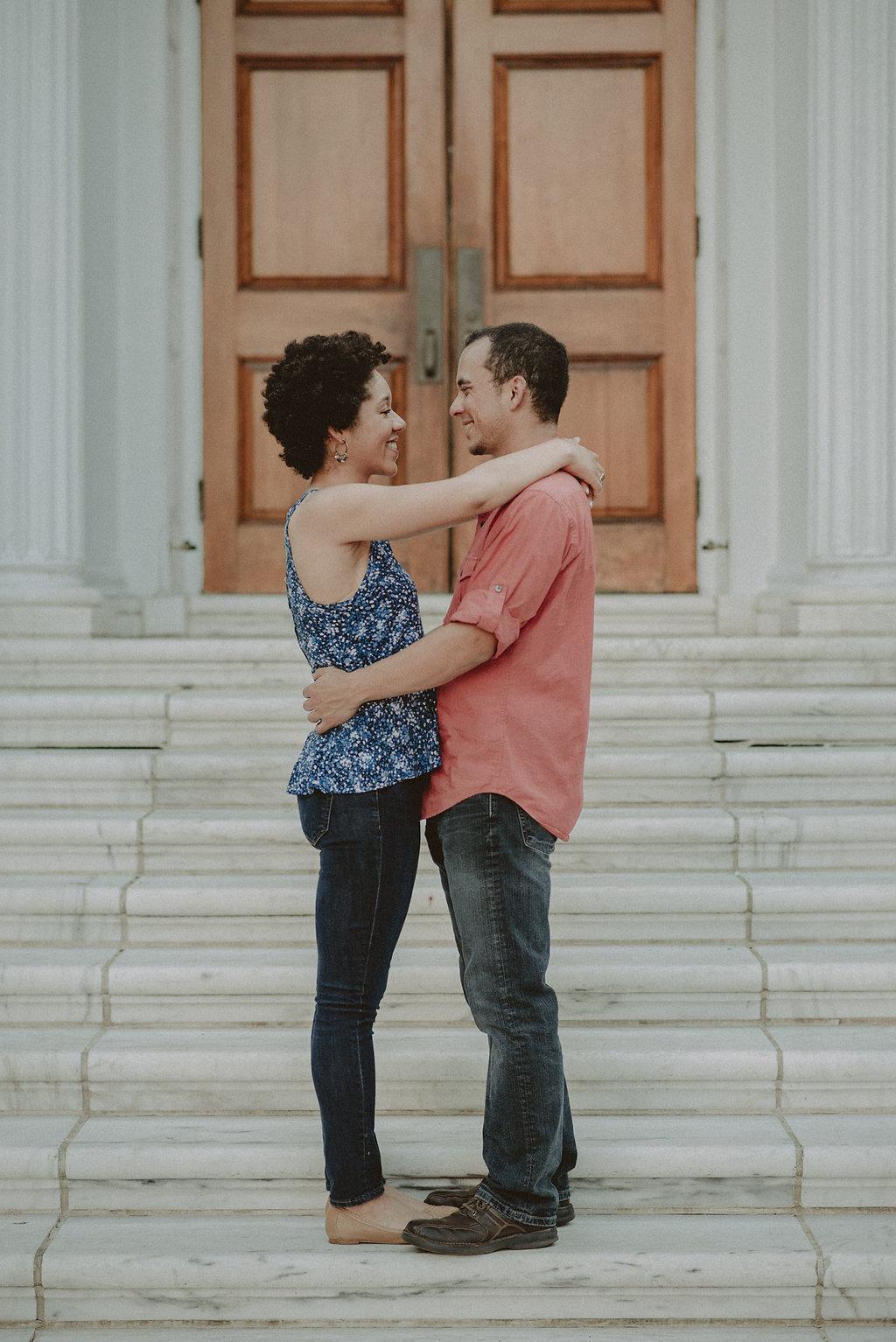 Couple hugging on steps