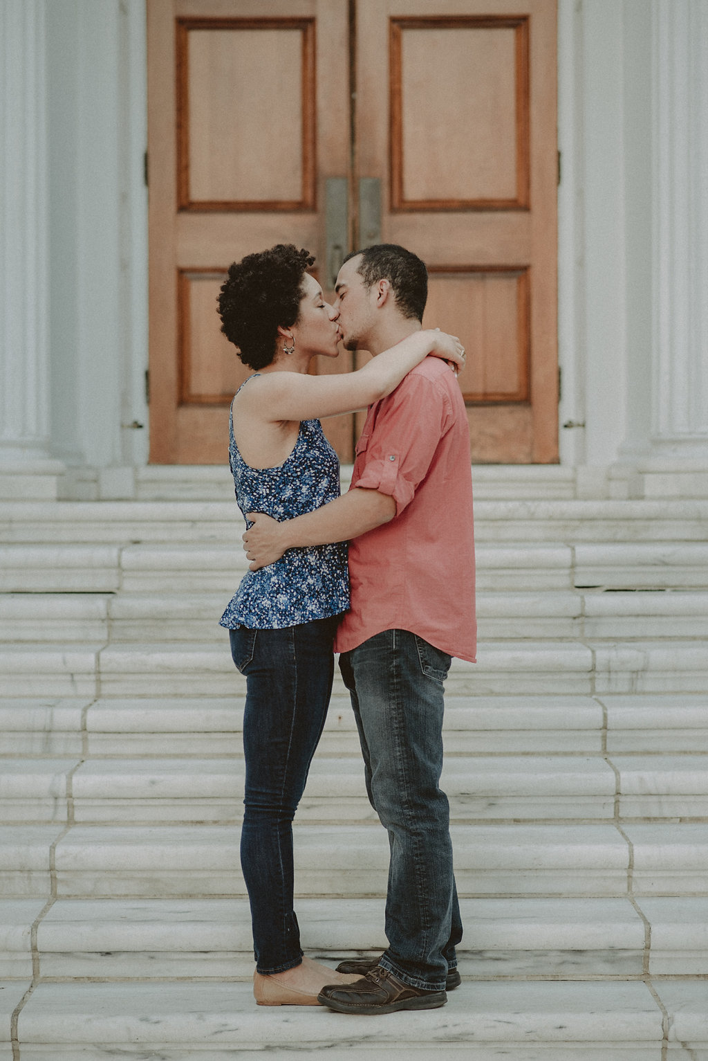 Couple kissing on steps