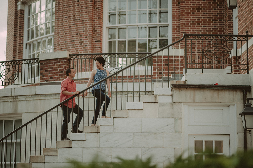Woman leading man up steps