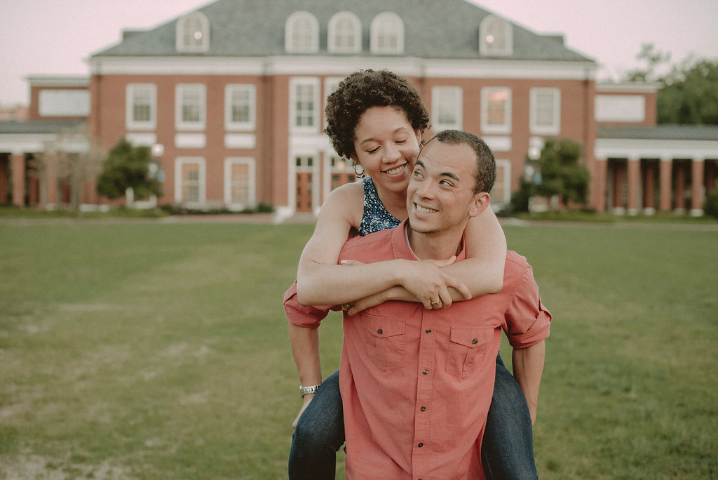 Man carrying woman on lawn