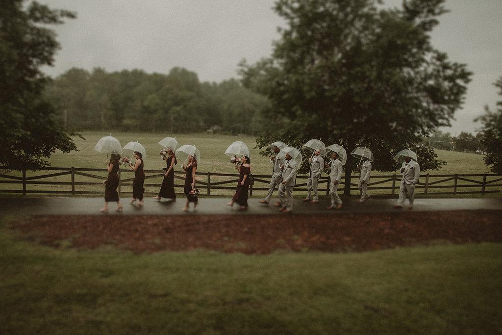 Wedding party walking in rain