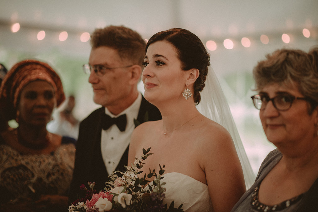 Bride arriving at altar with parents