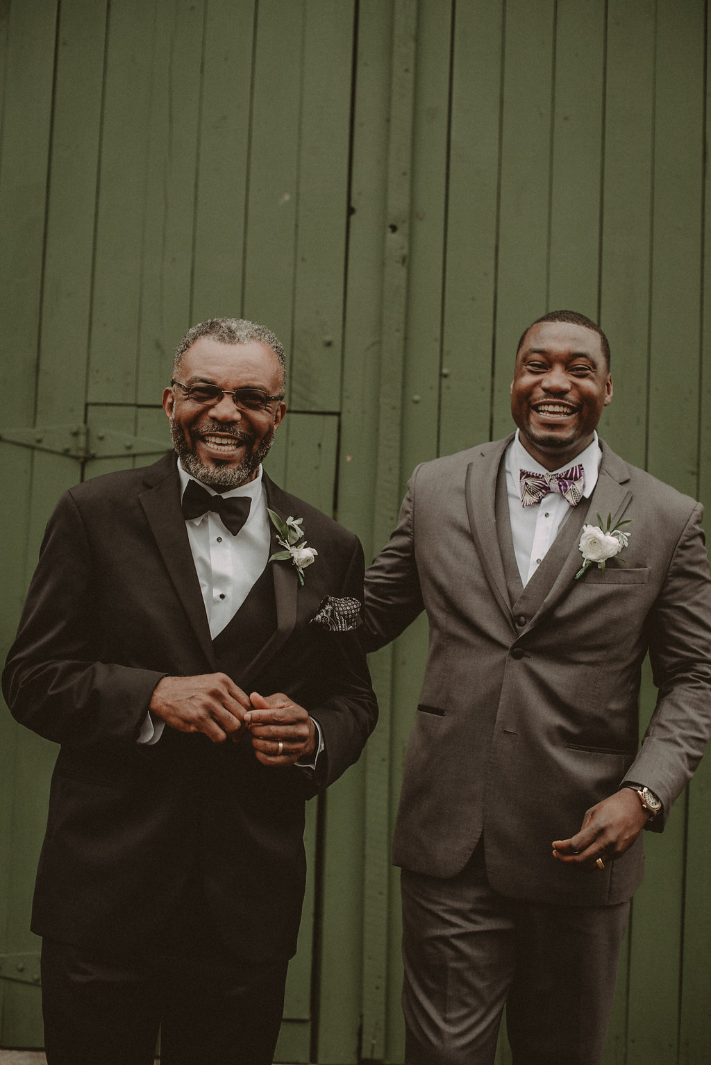 Groom and father after wedding