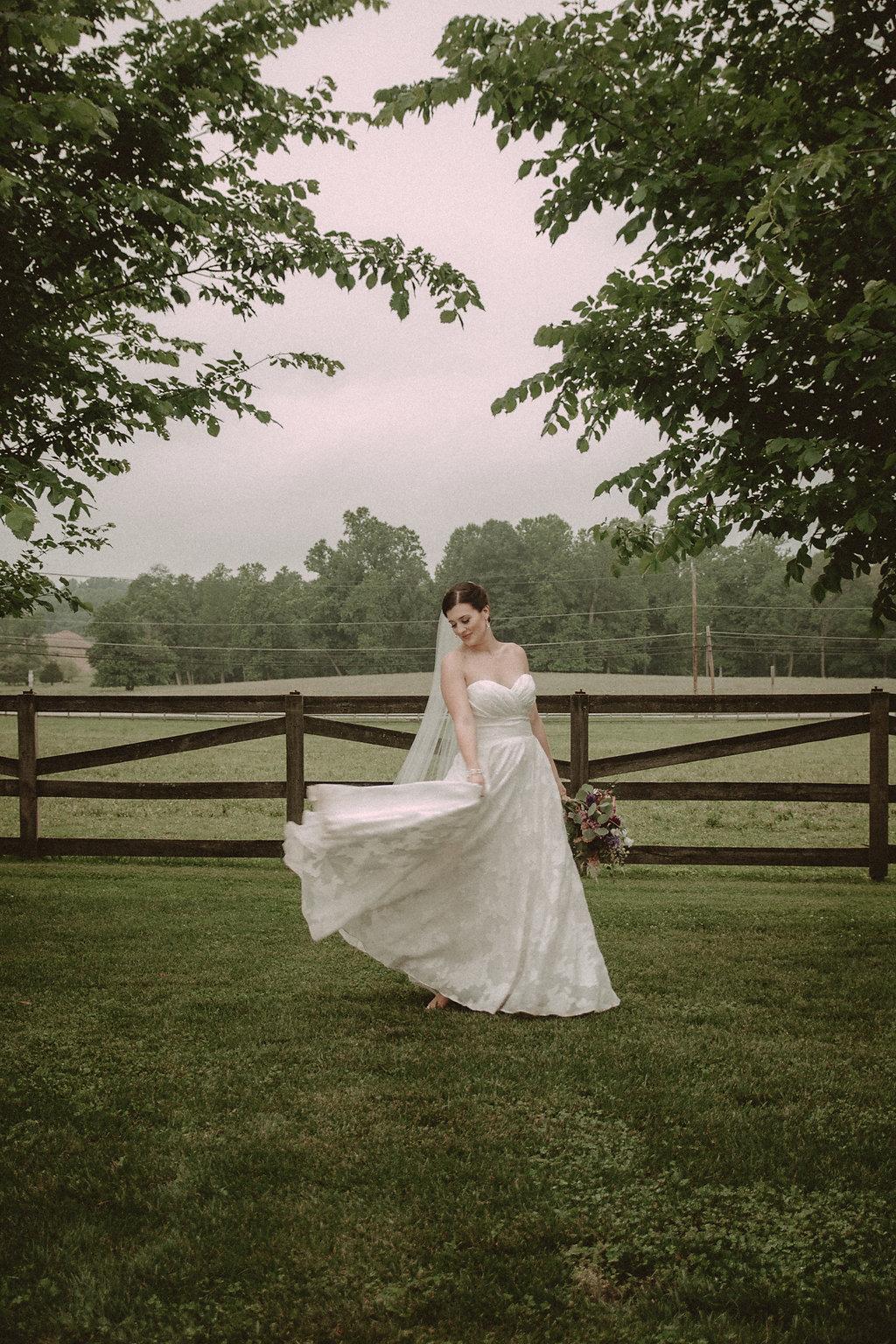 Bride posing in field
