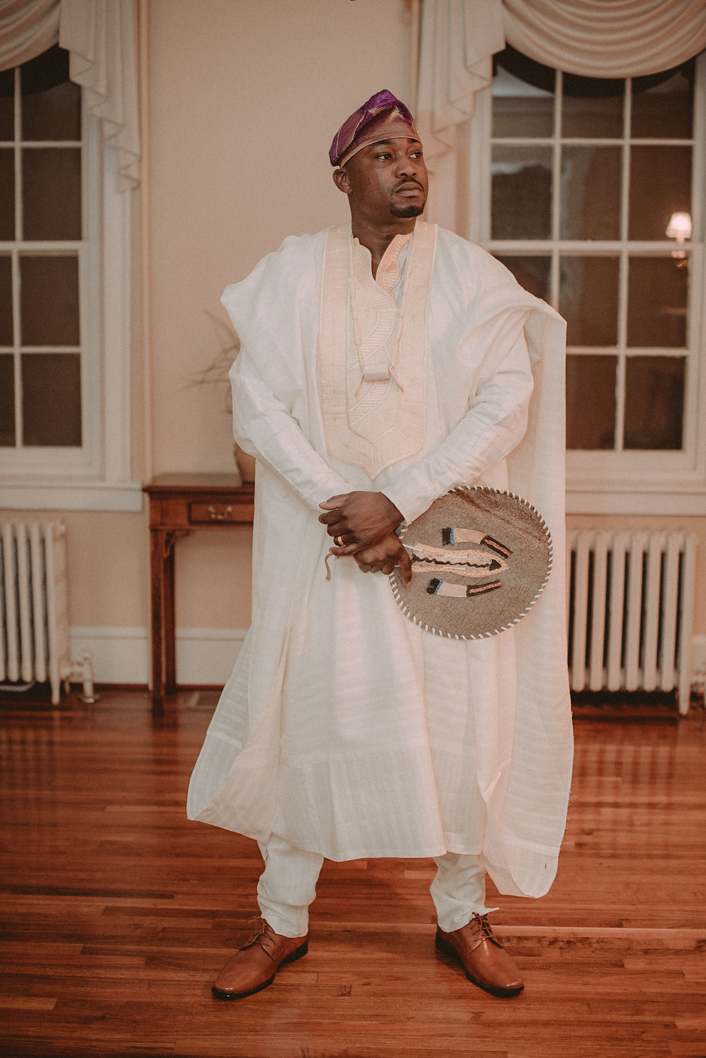 Groom in traditional clothing at reception