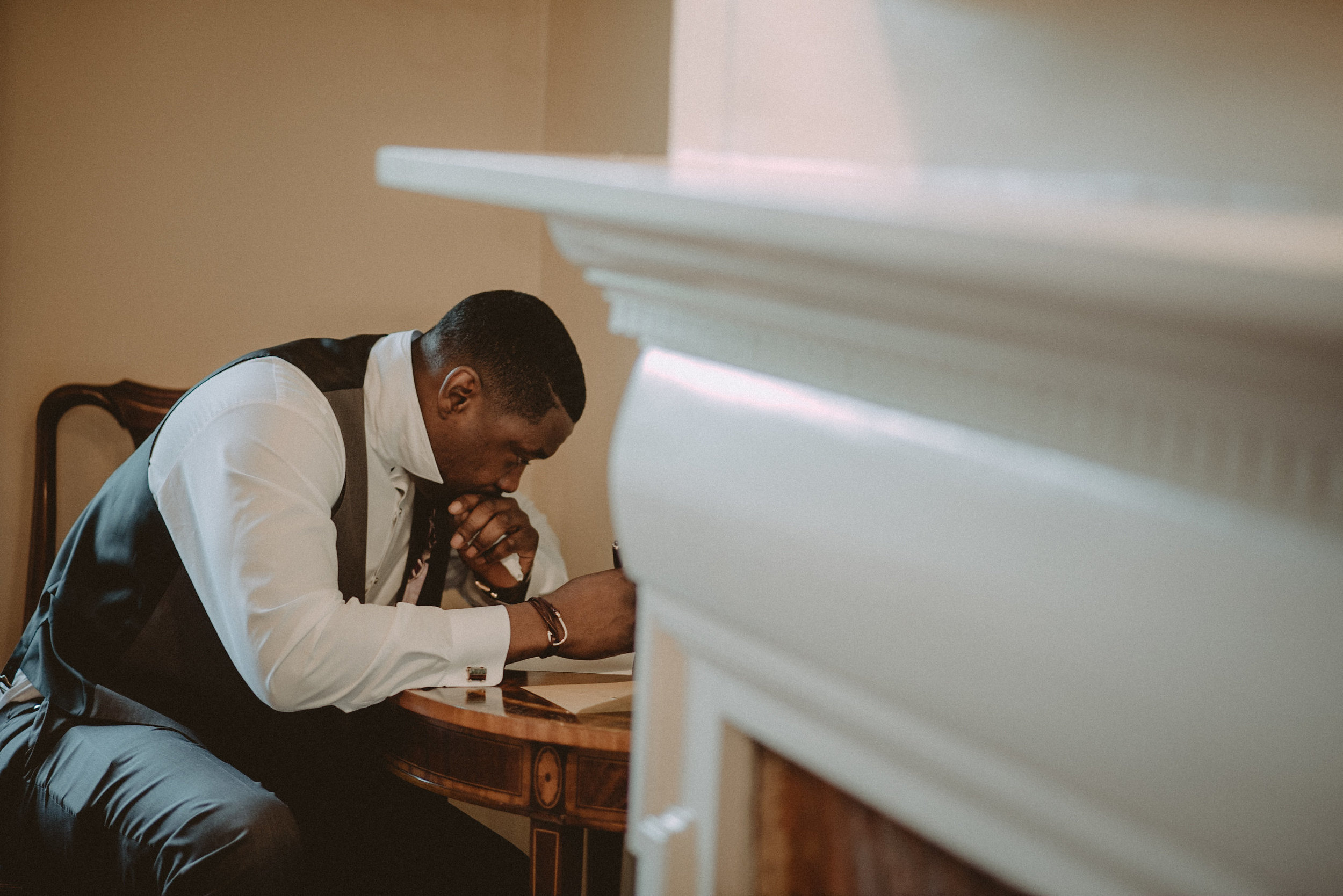 Groom writing letter