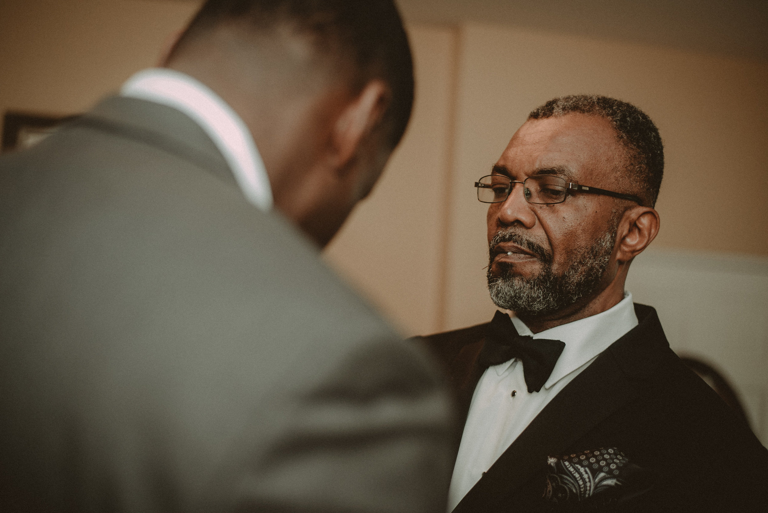 Groom and father getting ready for wedding