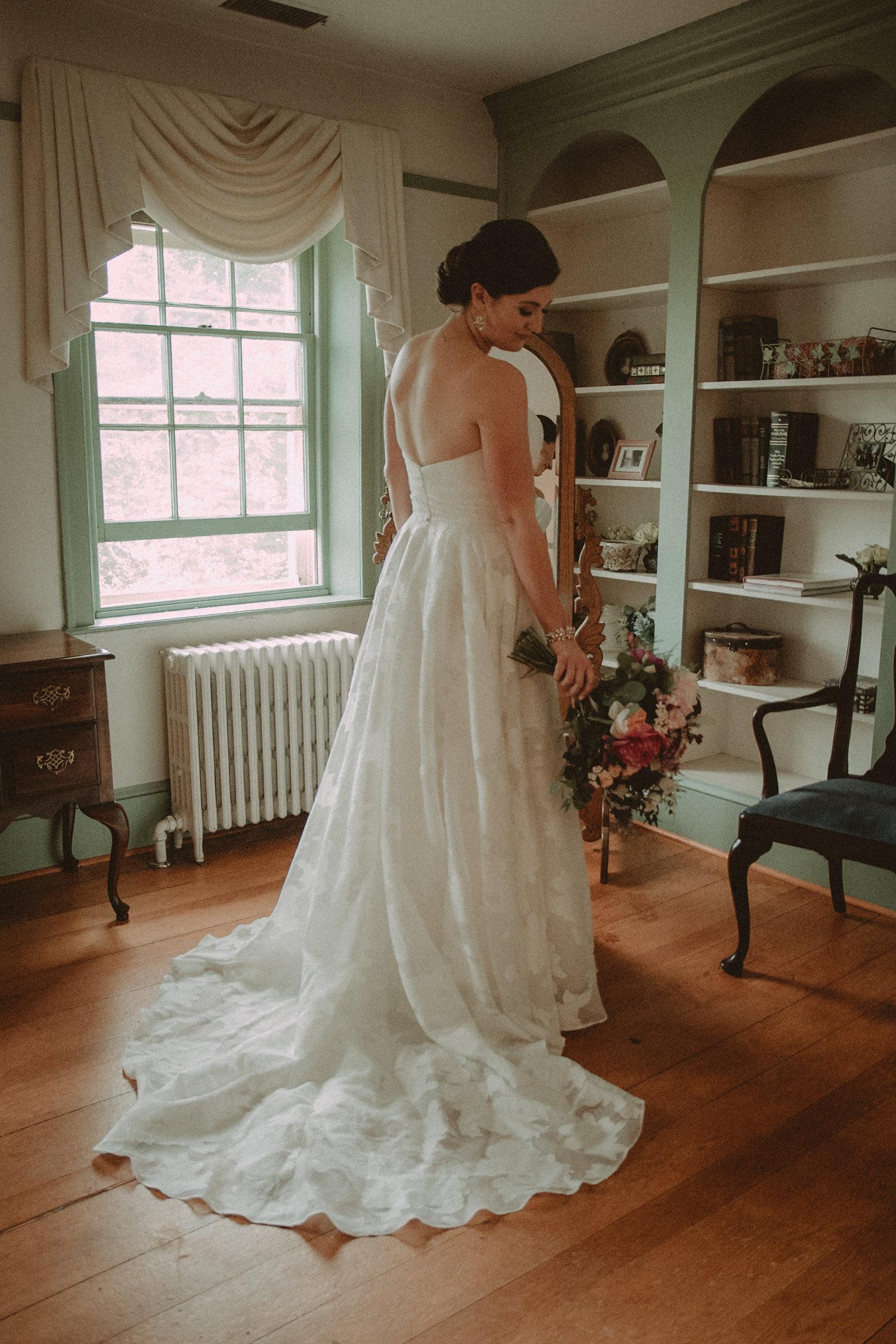 Bride posing in front of mirror