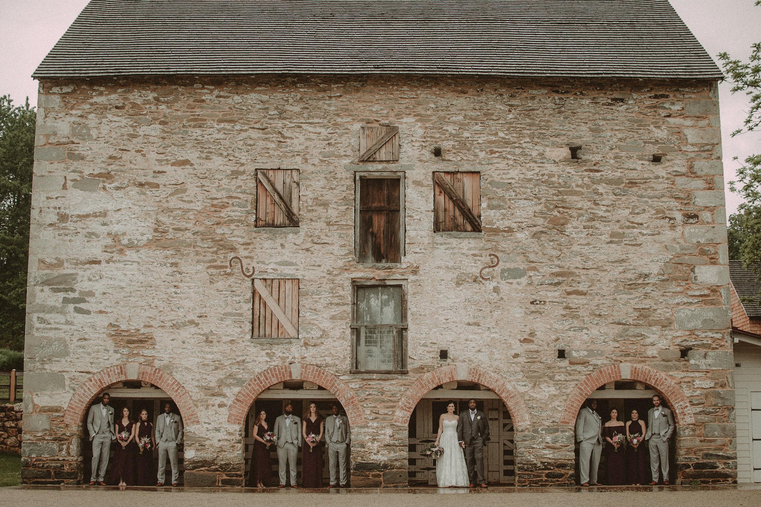 Wedding party under arches