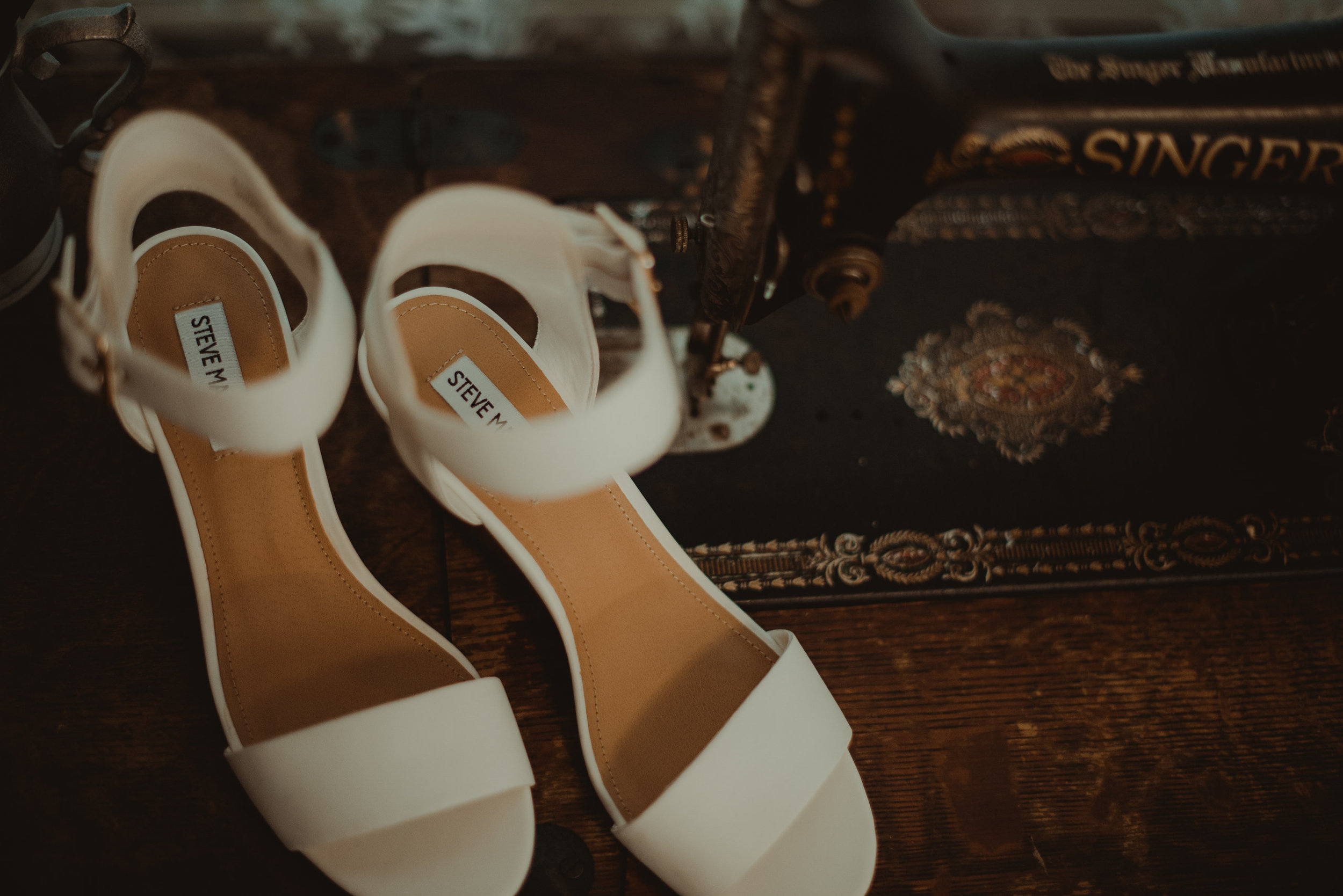 Wedding shoes on sewing machine