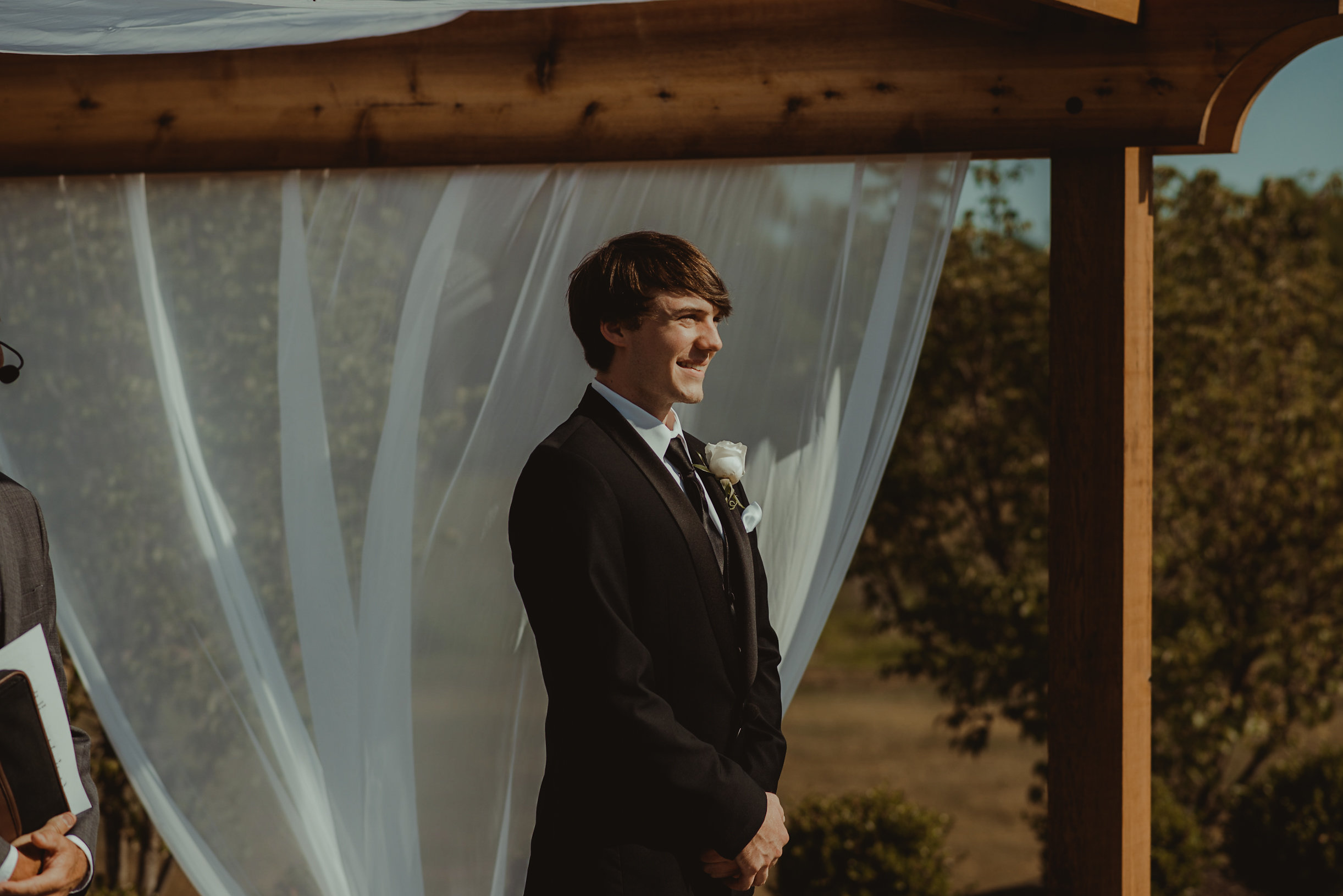 Groom standing at end of aisle