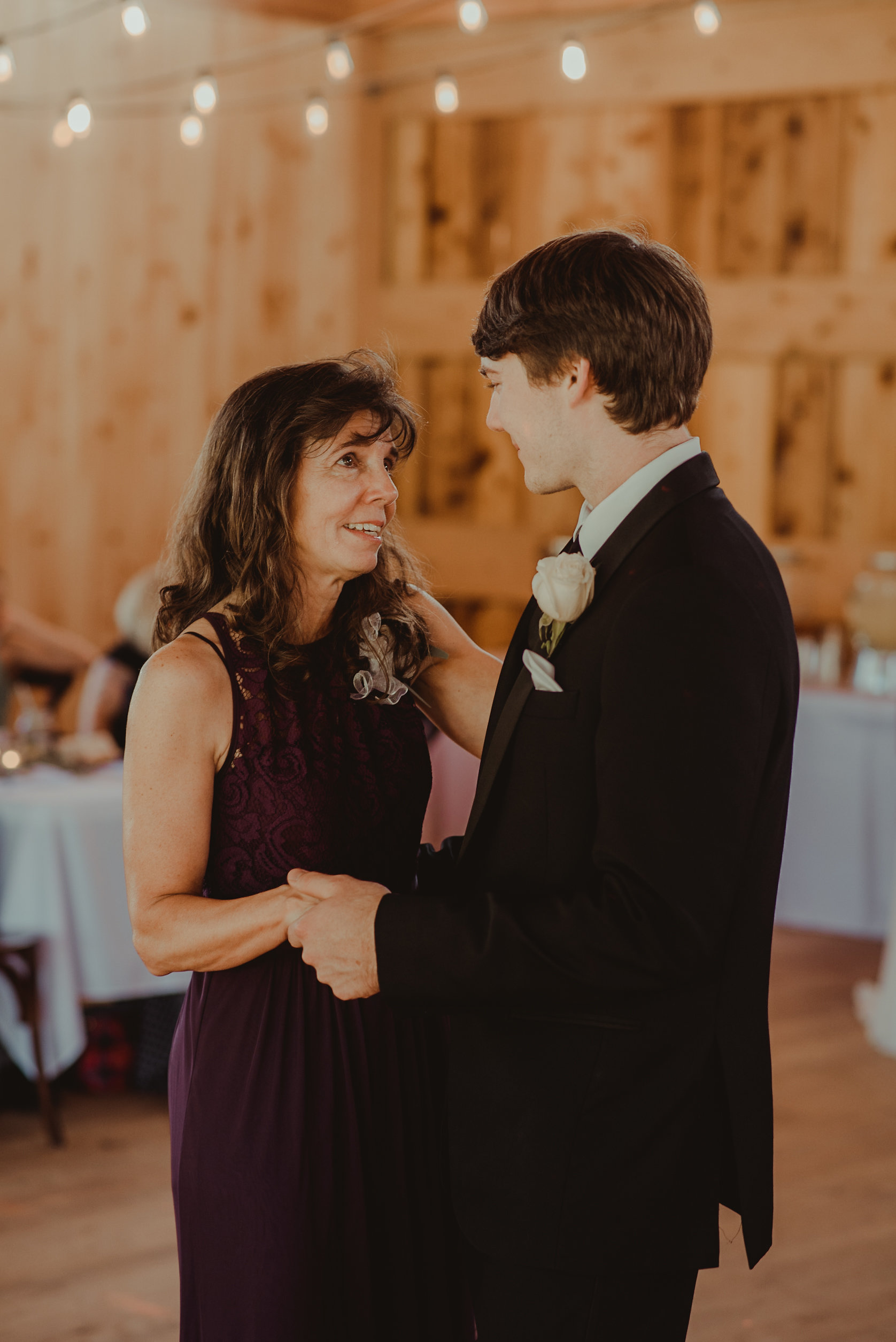 Mother and groom dance