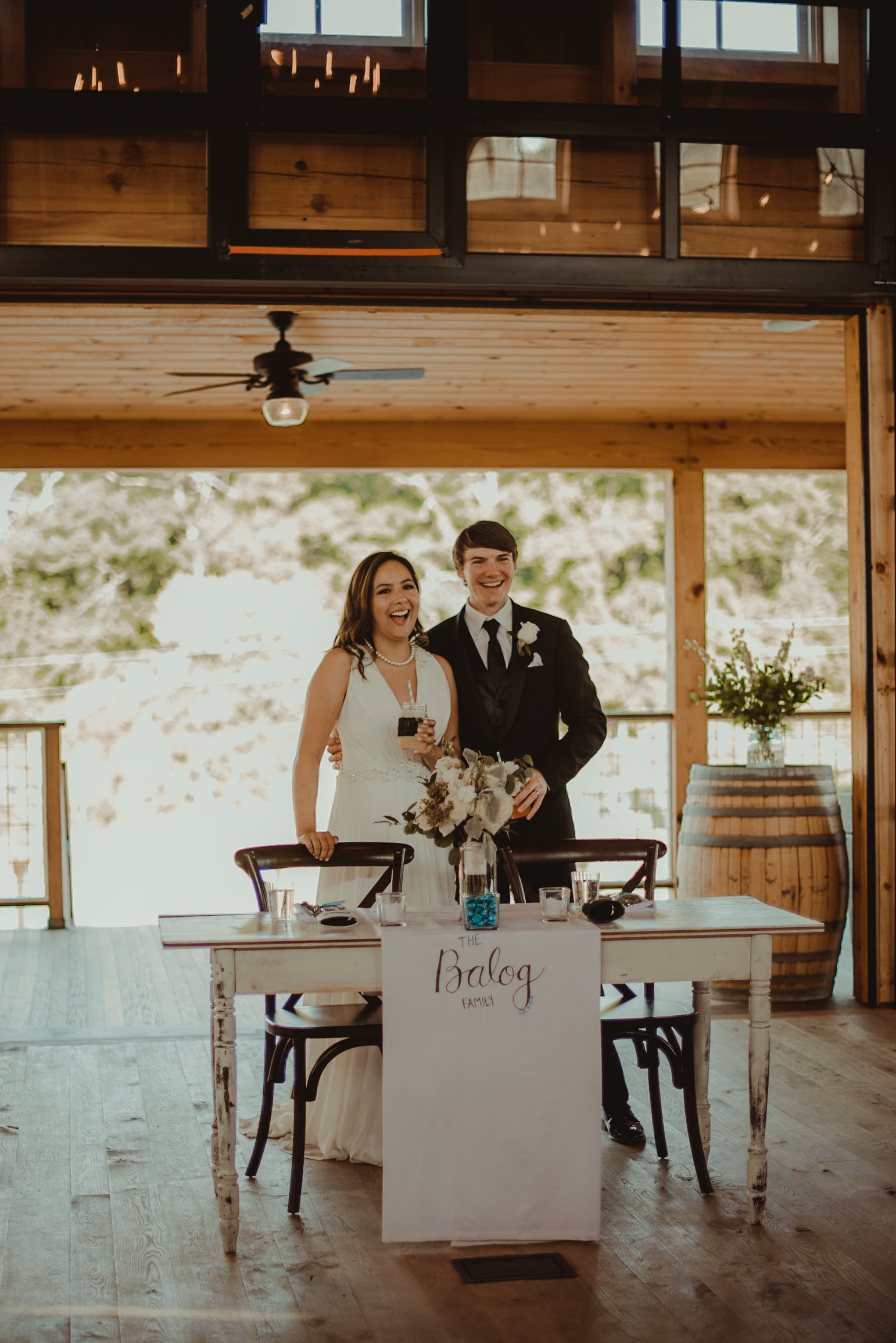 Bride and groom in front of table