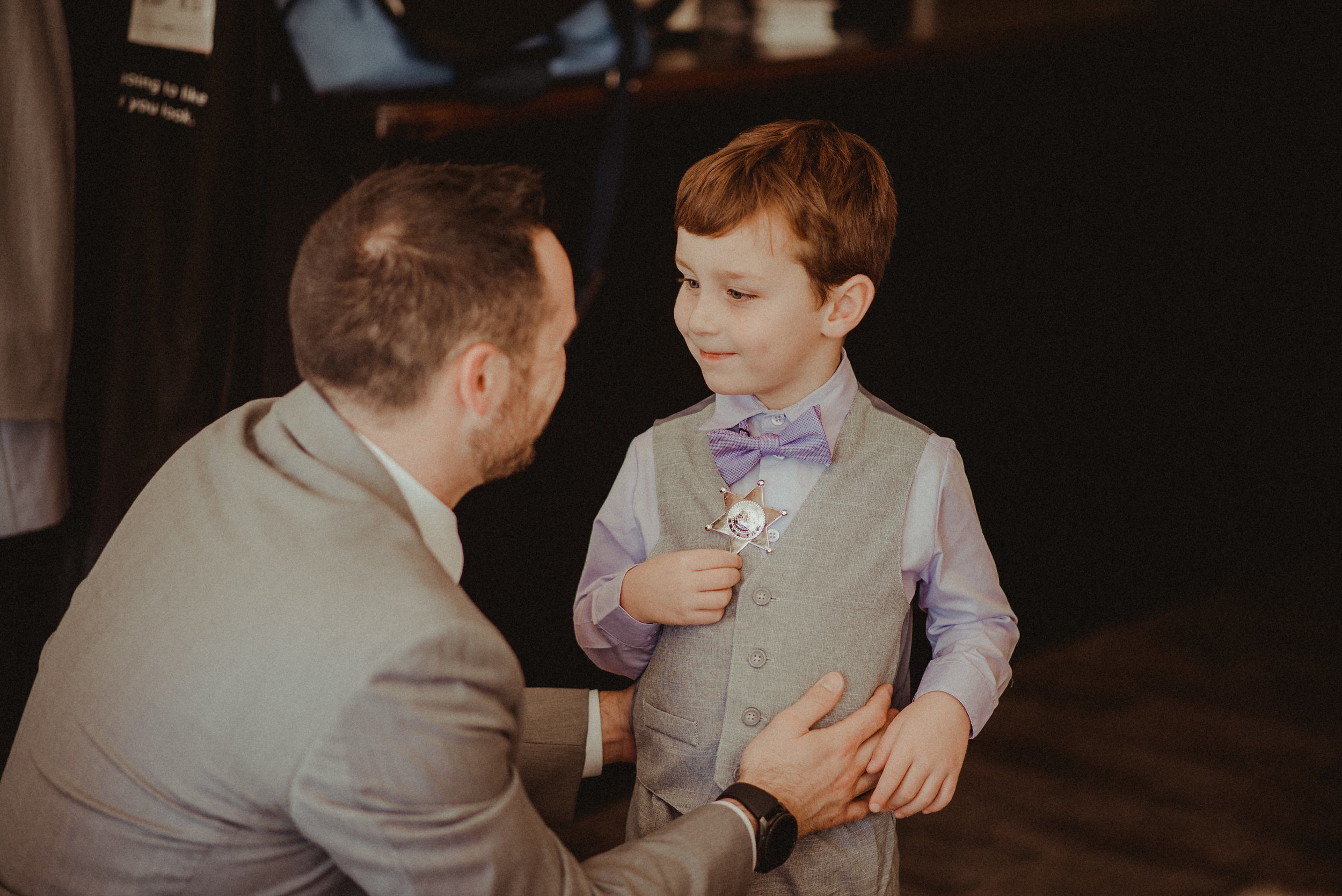 Groom and son on wedding day