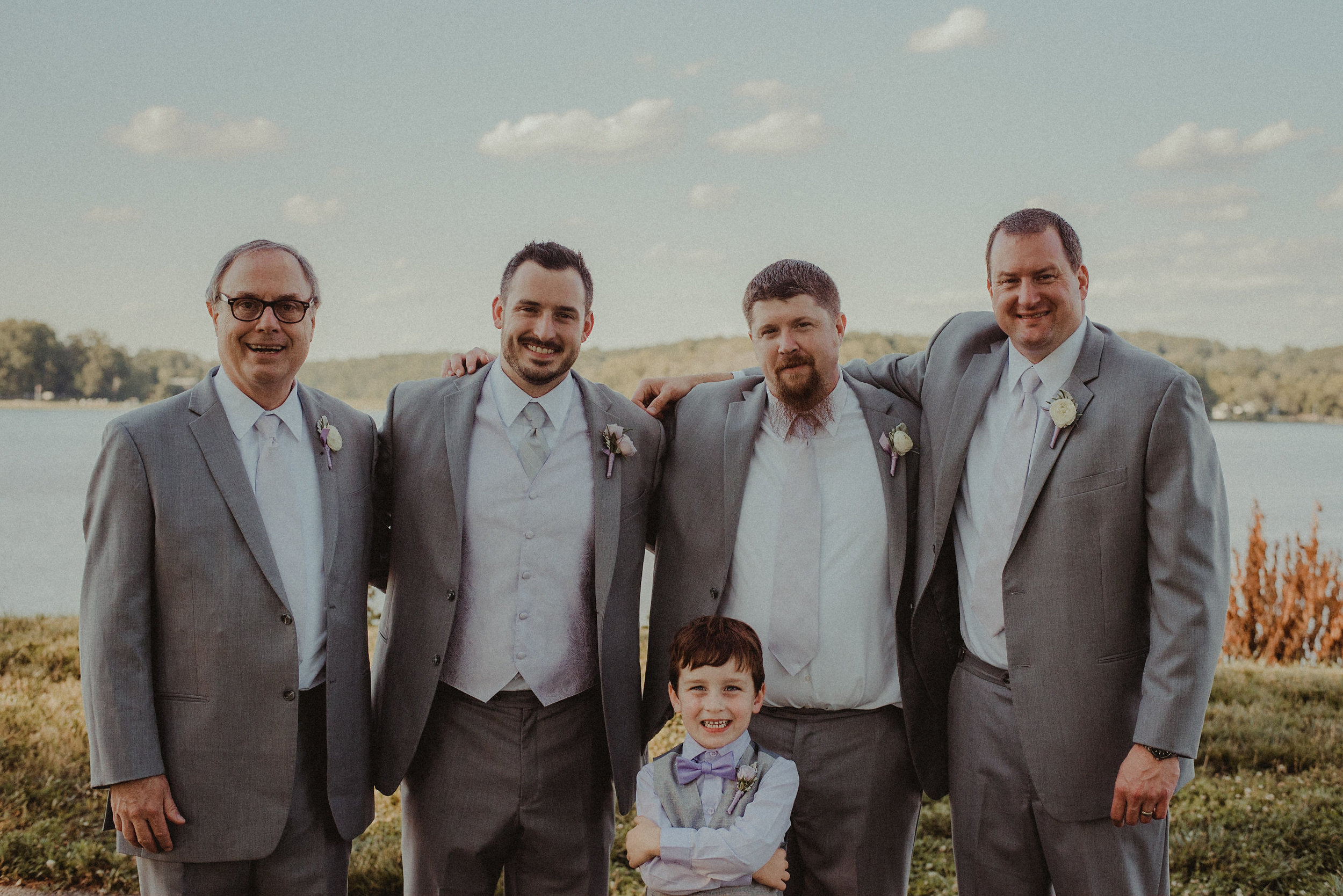 Groom and groomsmen in front of lake