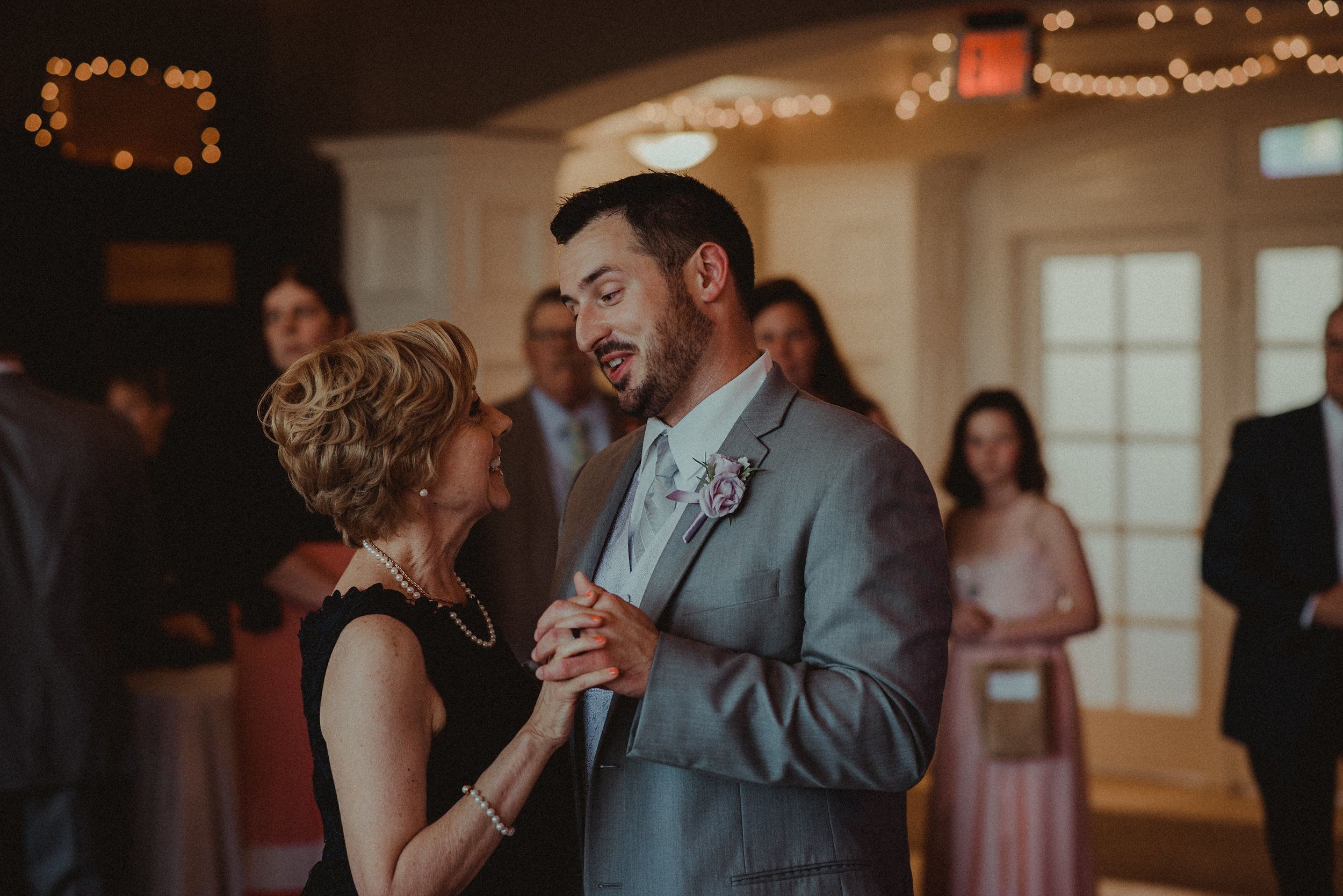 Groom dancing with mother in law