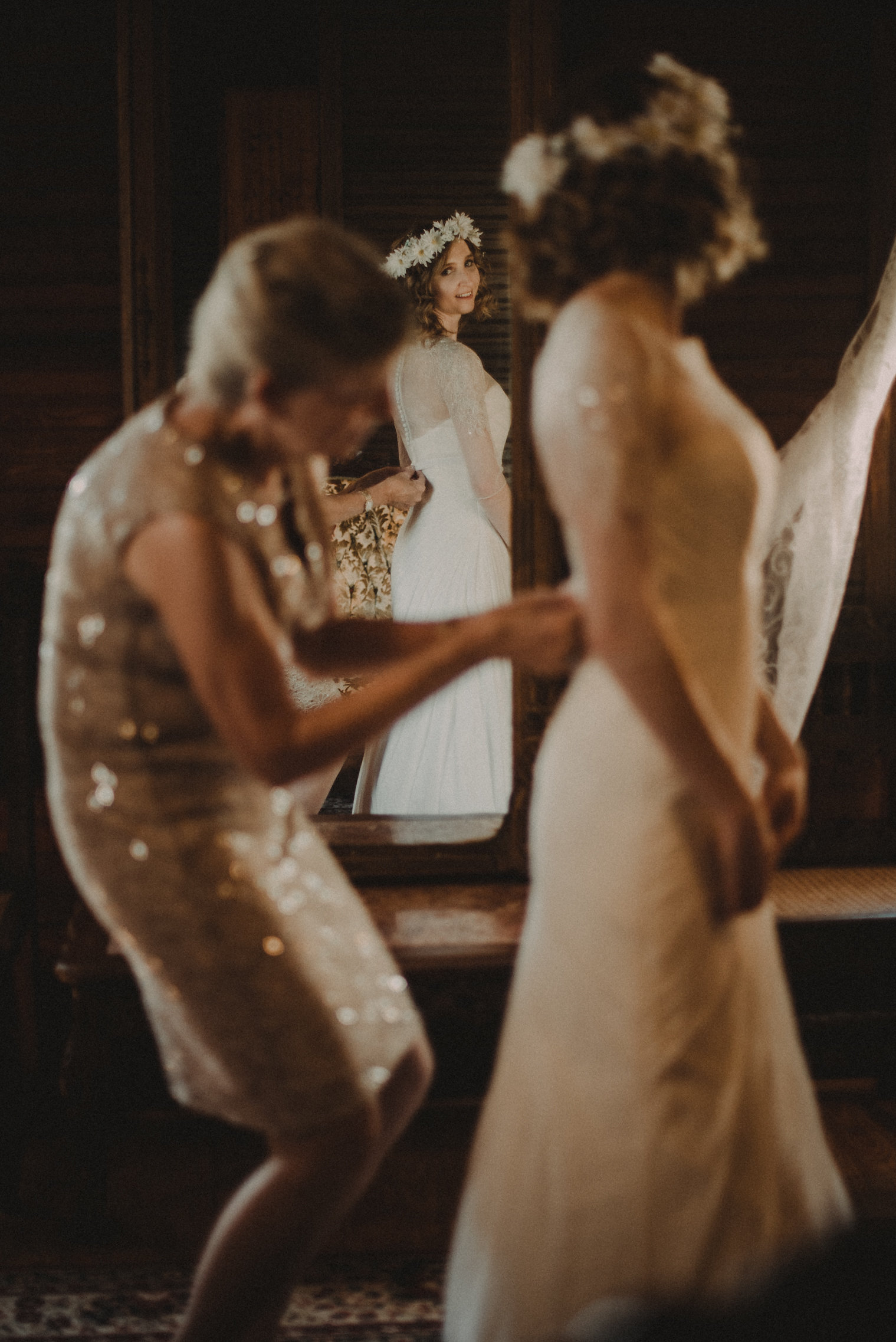 Bride getting dressed for wedding