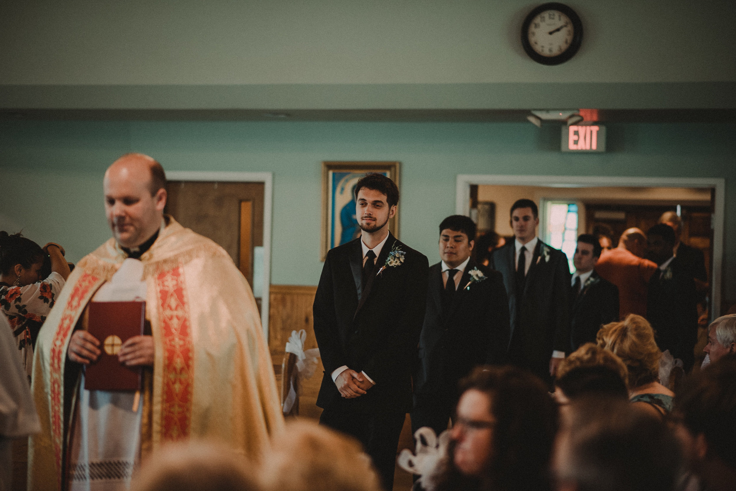 Groom entering church for wedding
