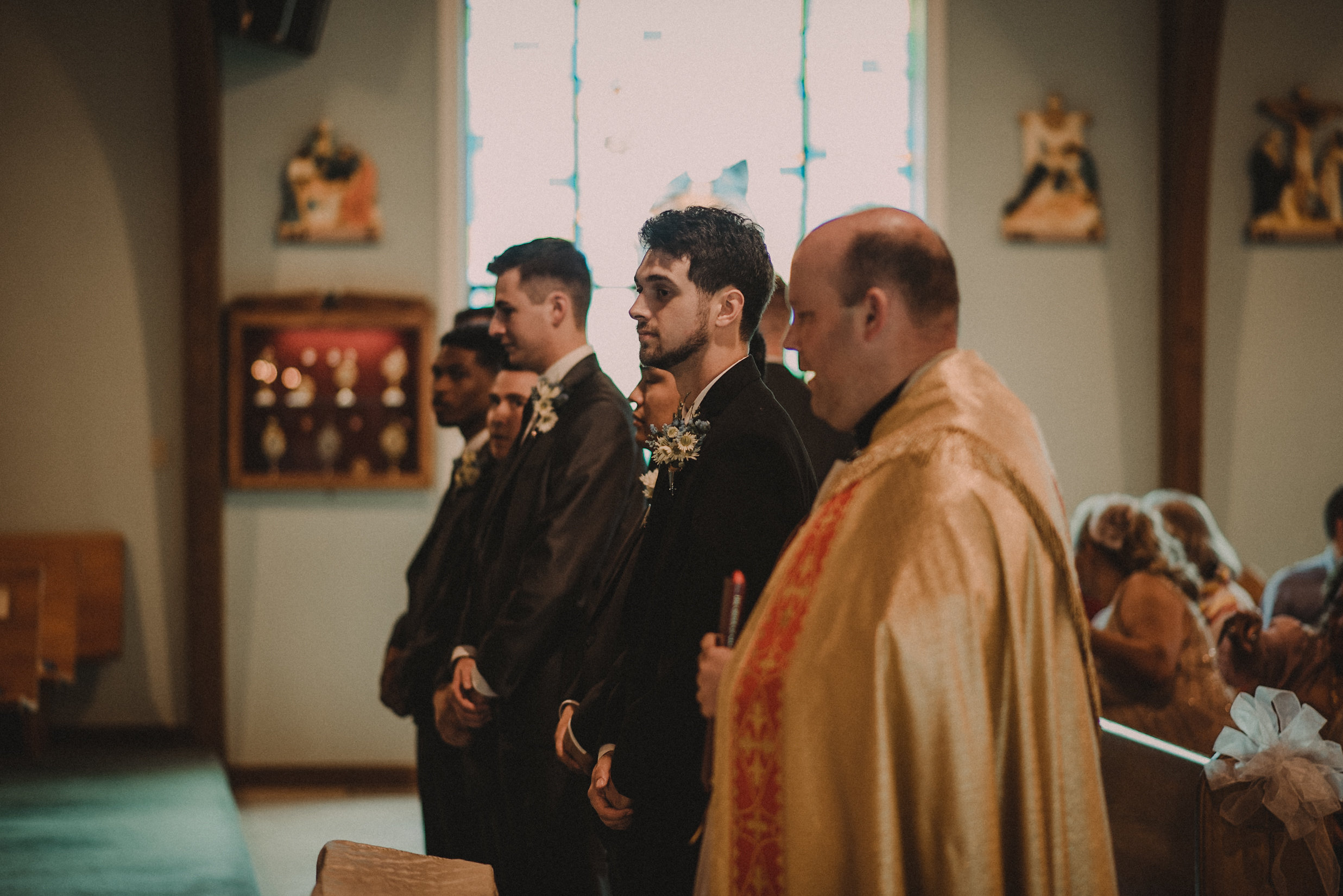 Groom standing at altar in church