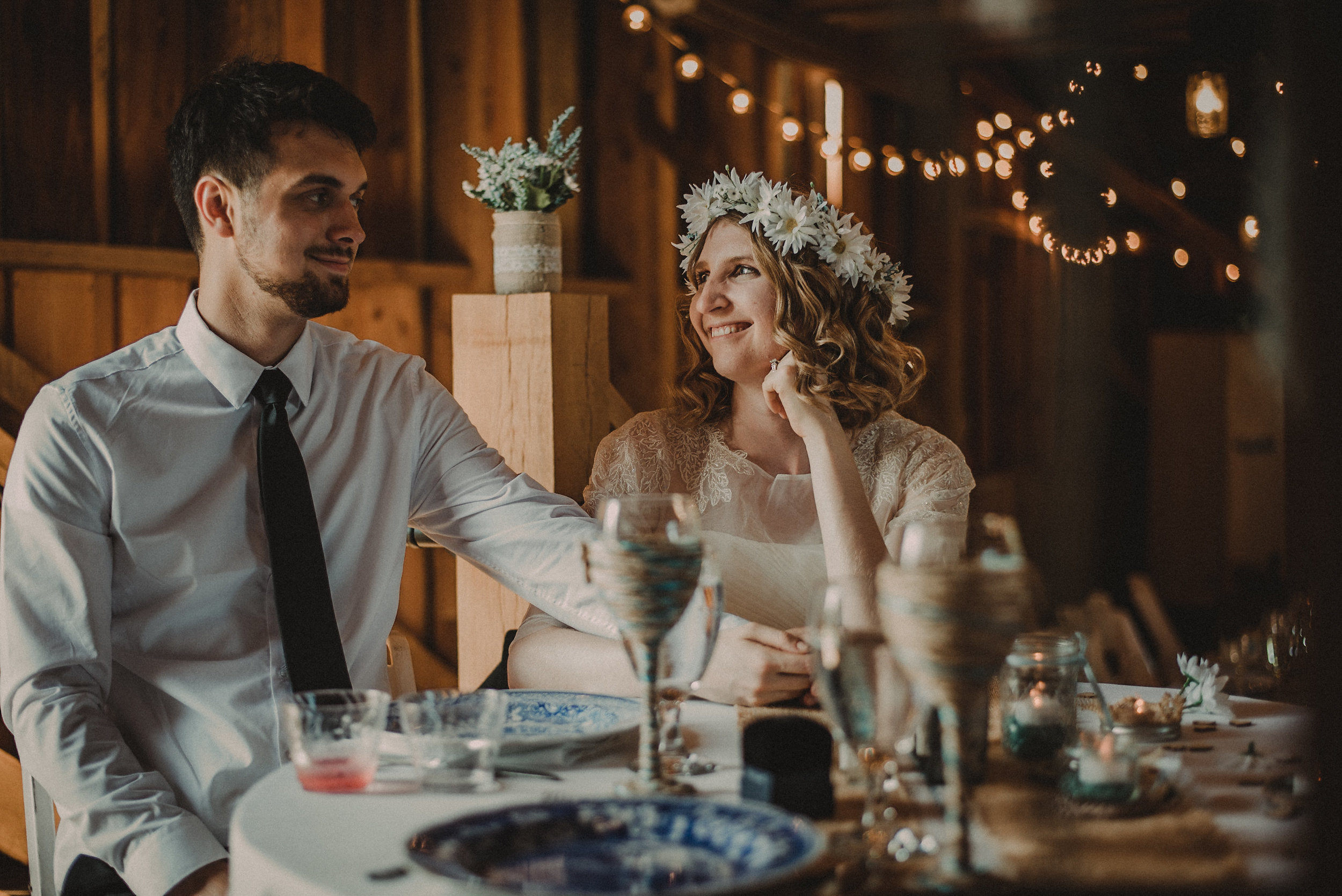 Bride and groom at reception table