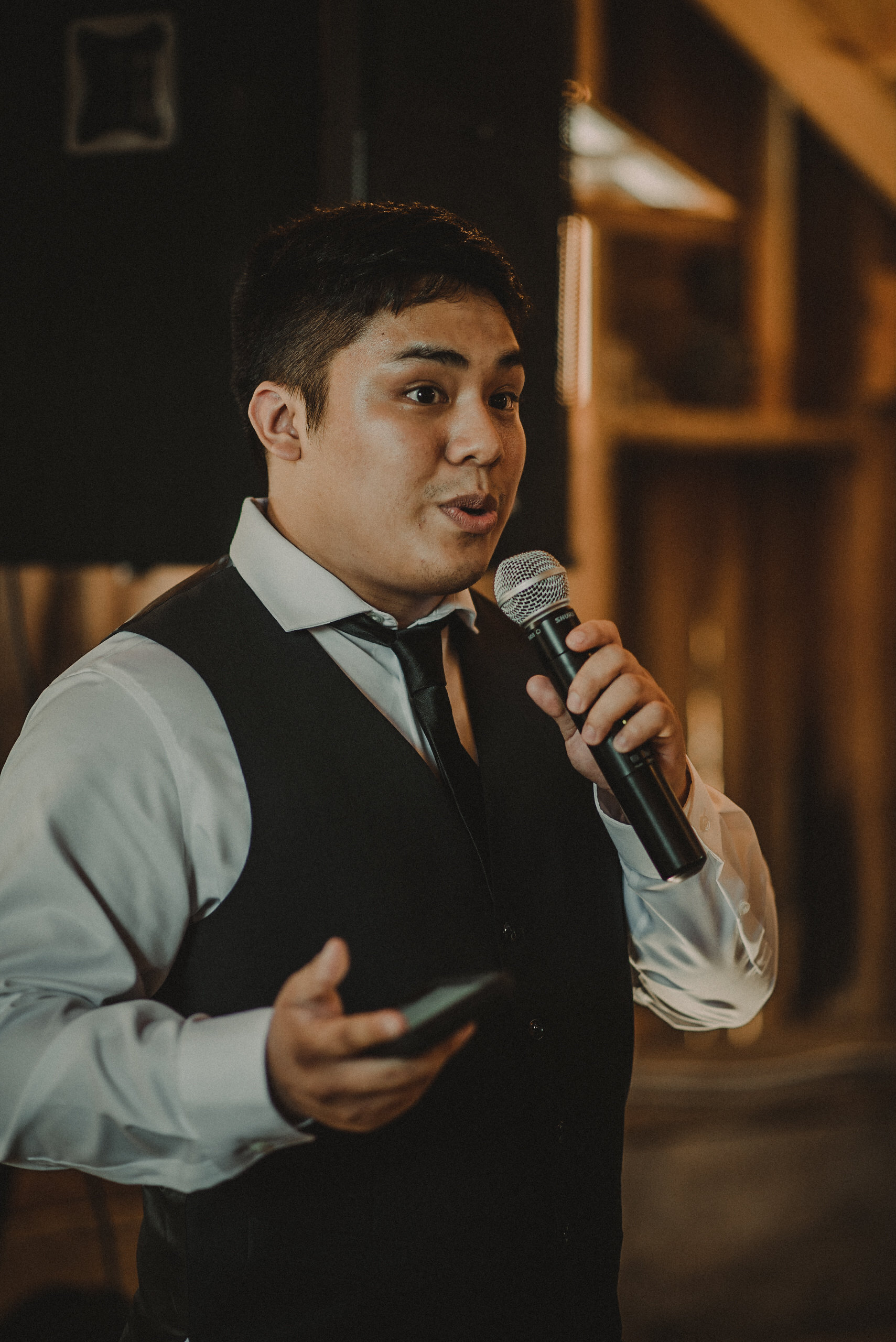 Groomsman giving speech at wedding
