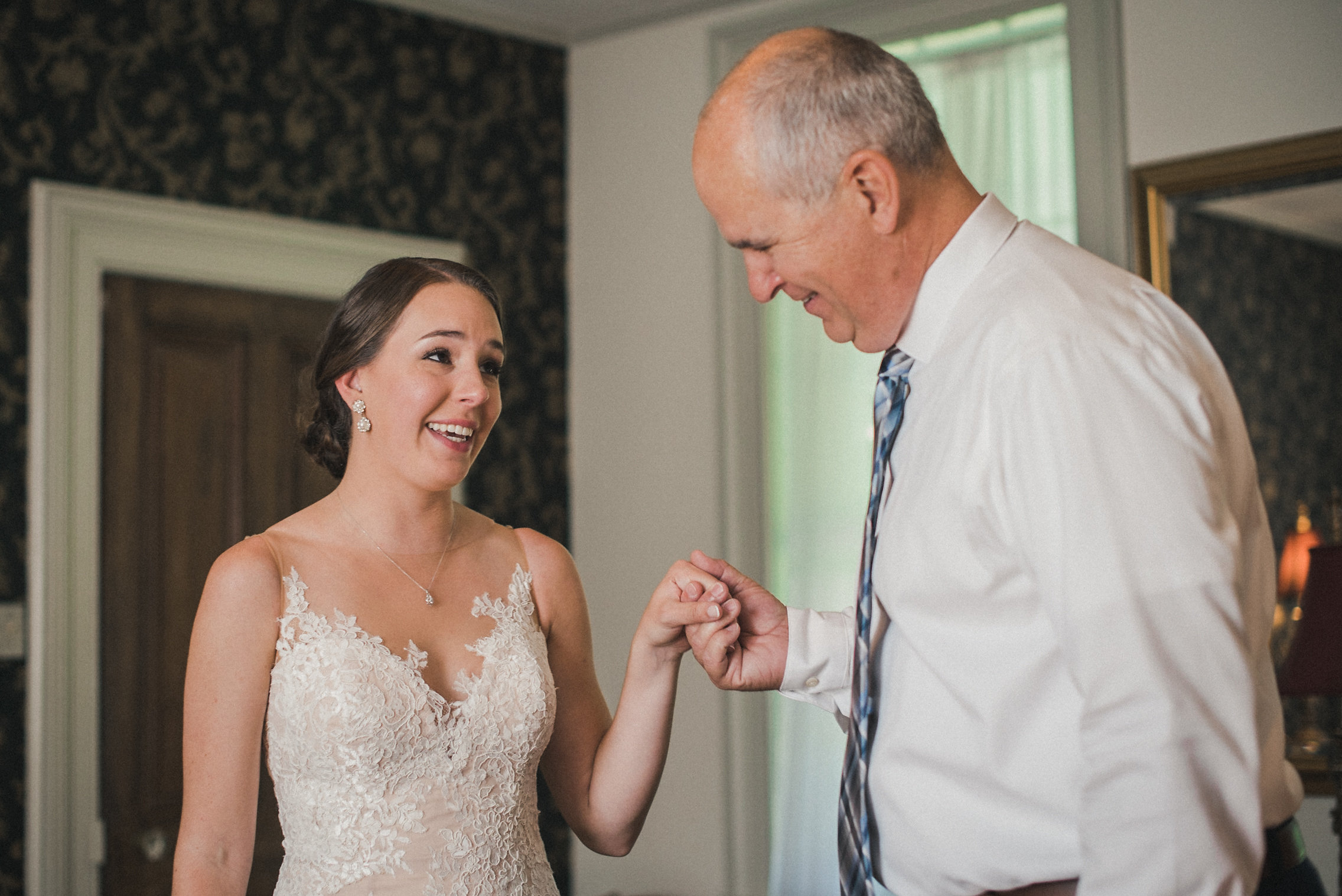 Bride and father tearing up