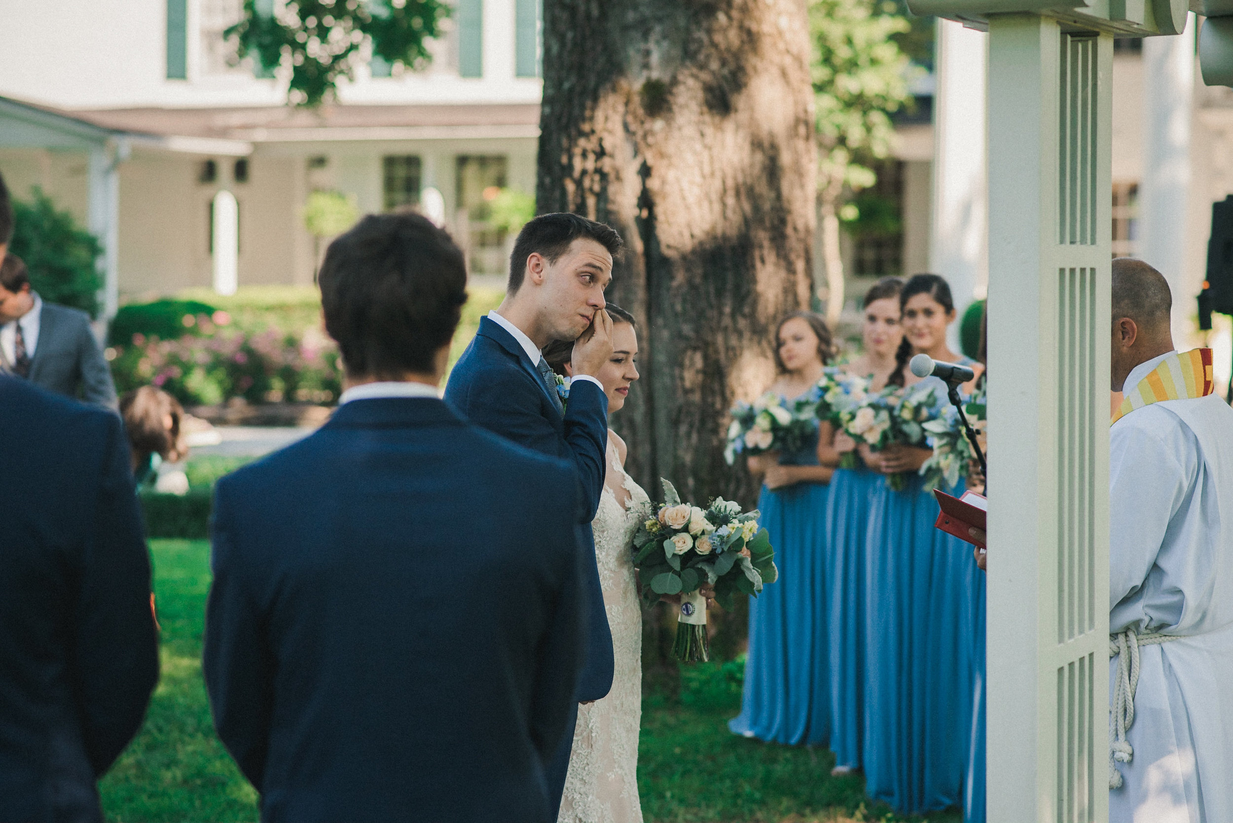 Groom crying at altar