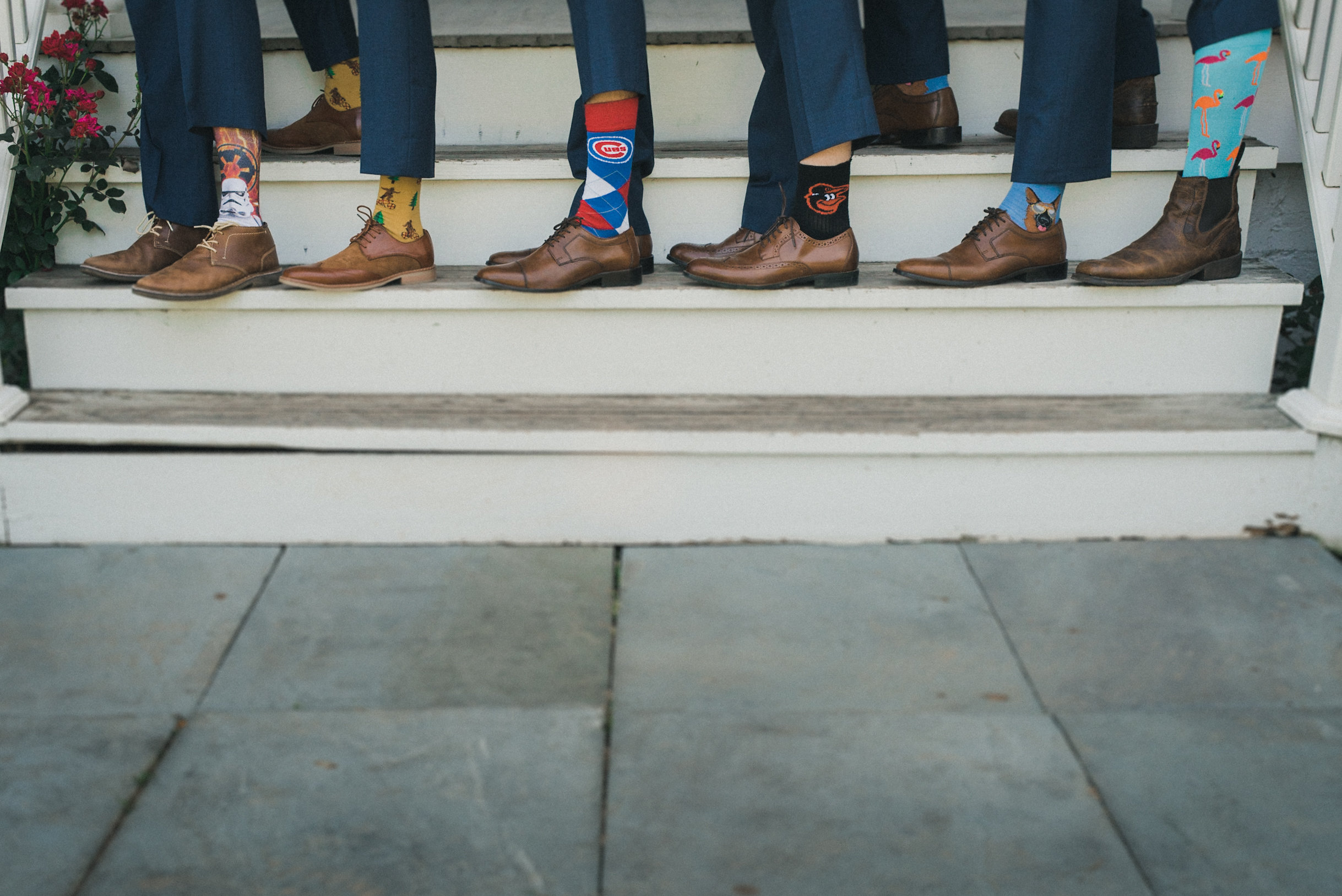 Groomsmen wearing statement socks