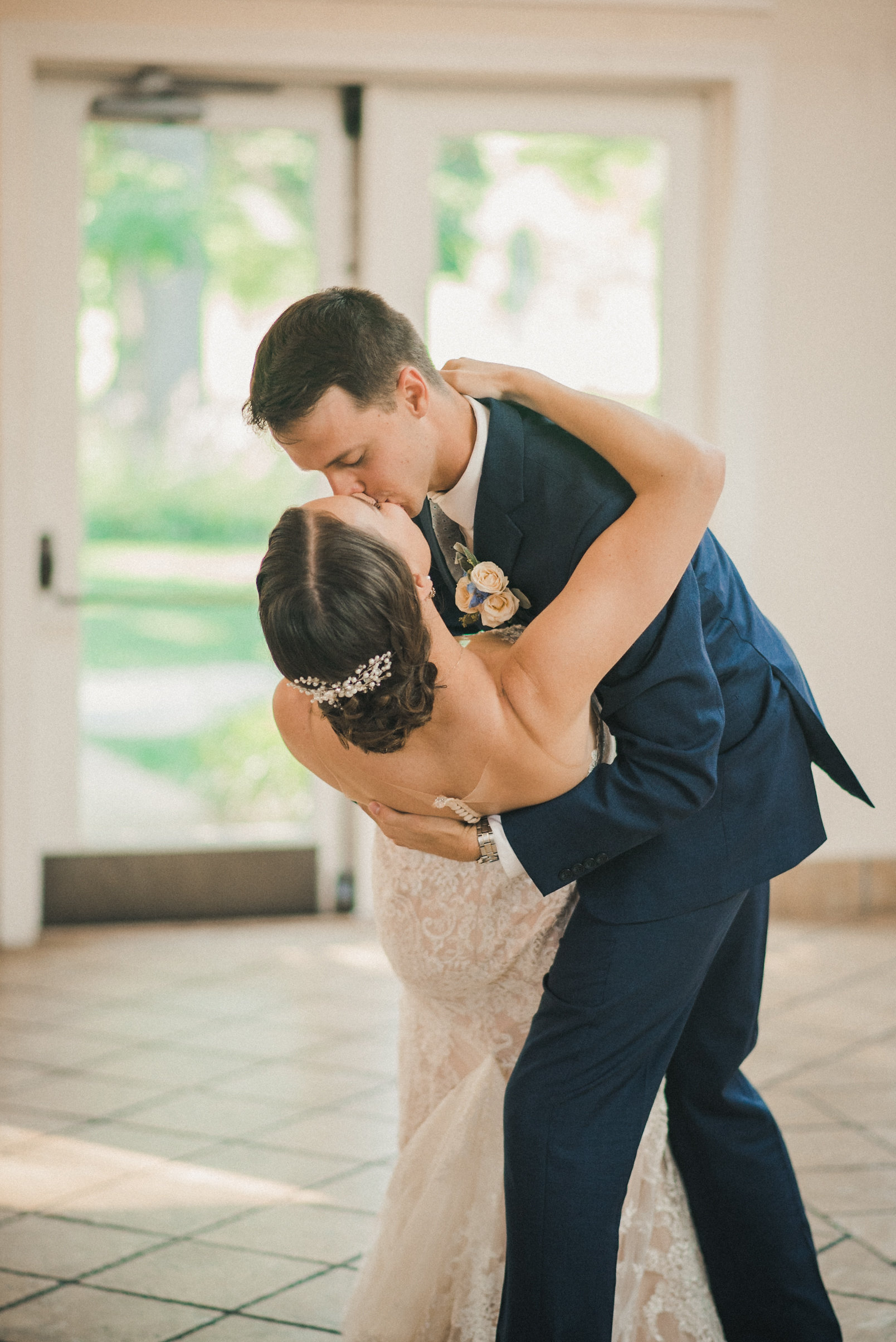 Groom dipping bride during dance