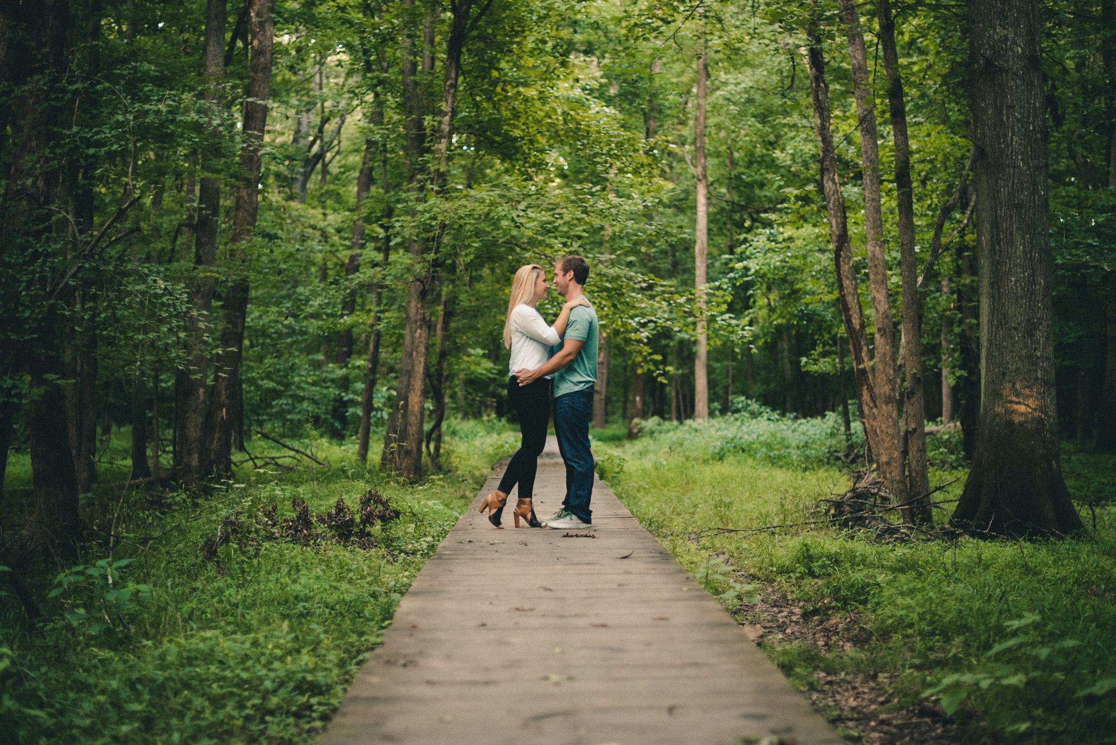 Couple facing one another on trail