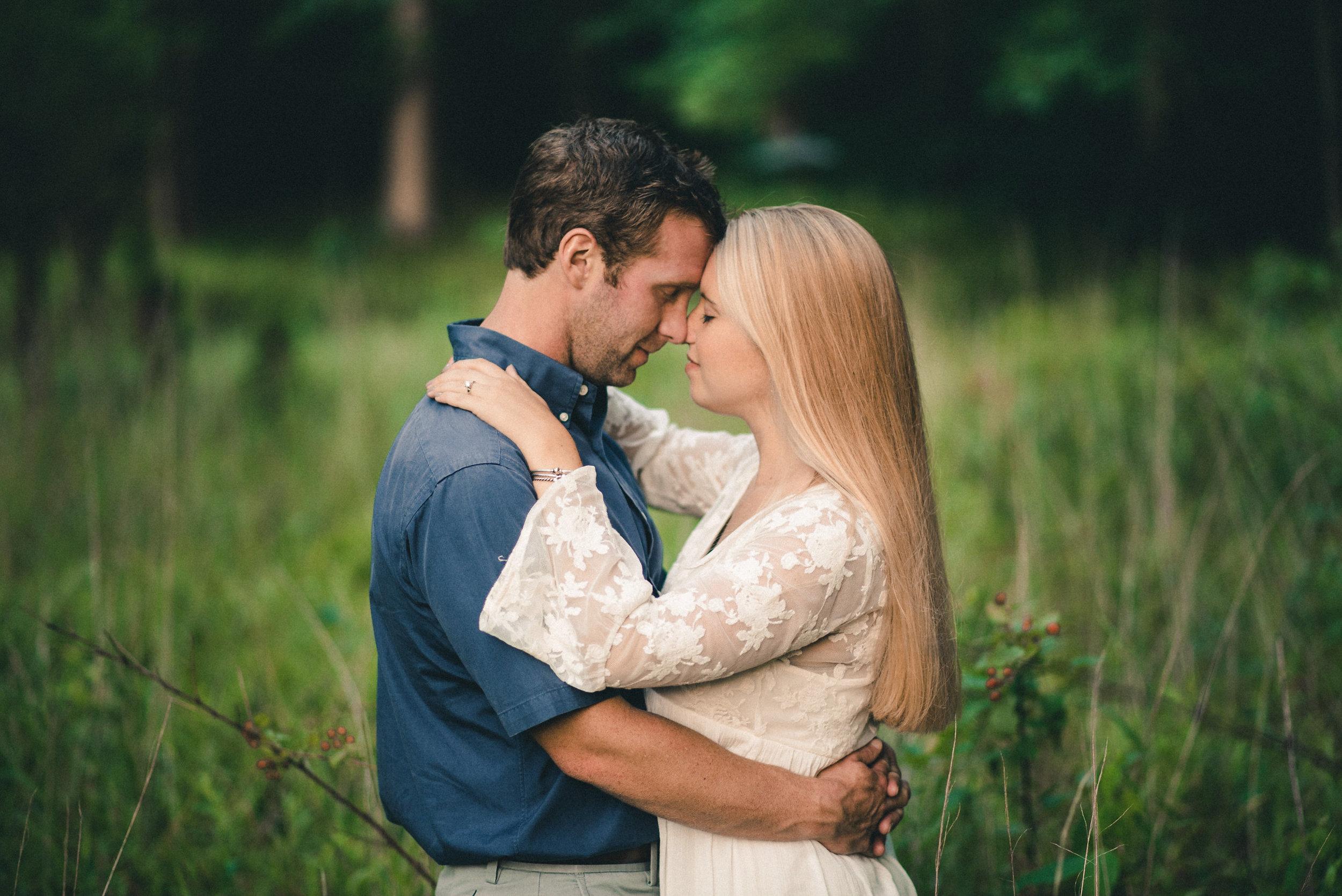 Couple hugging in field
