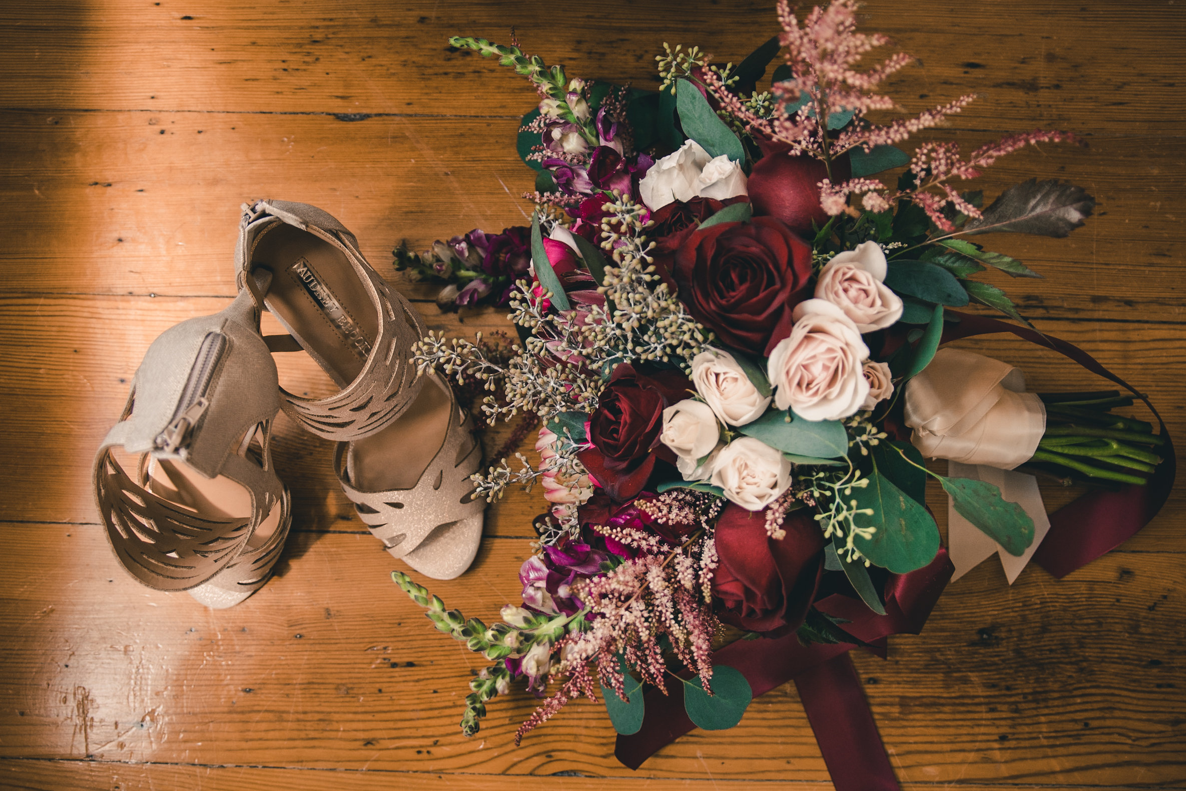 Bride's shoes and flowers seen from above