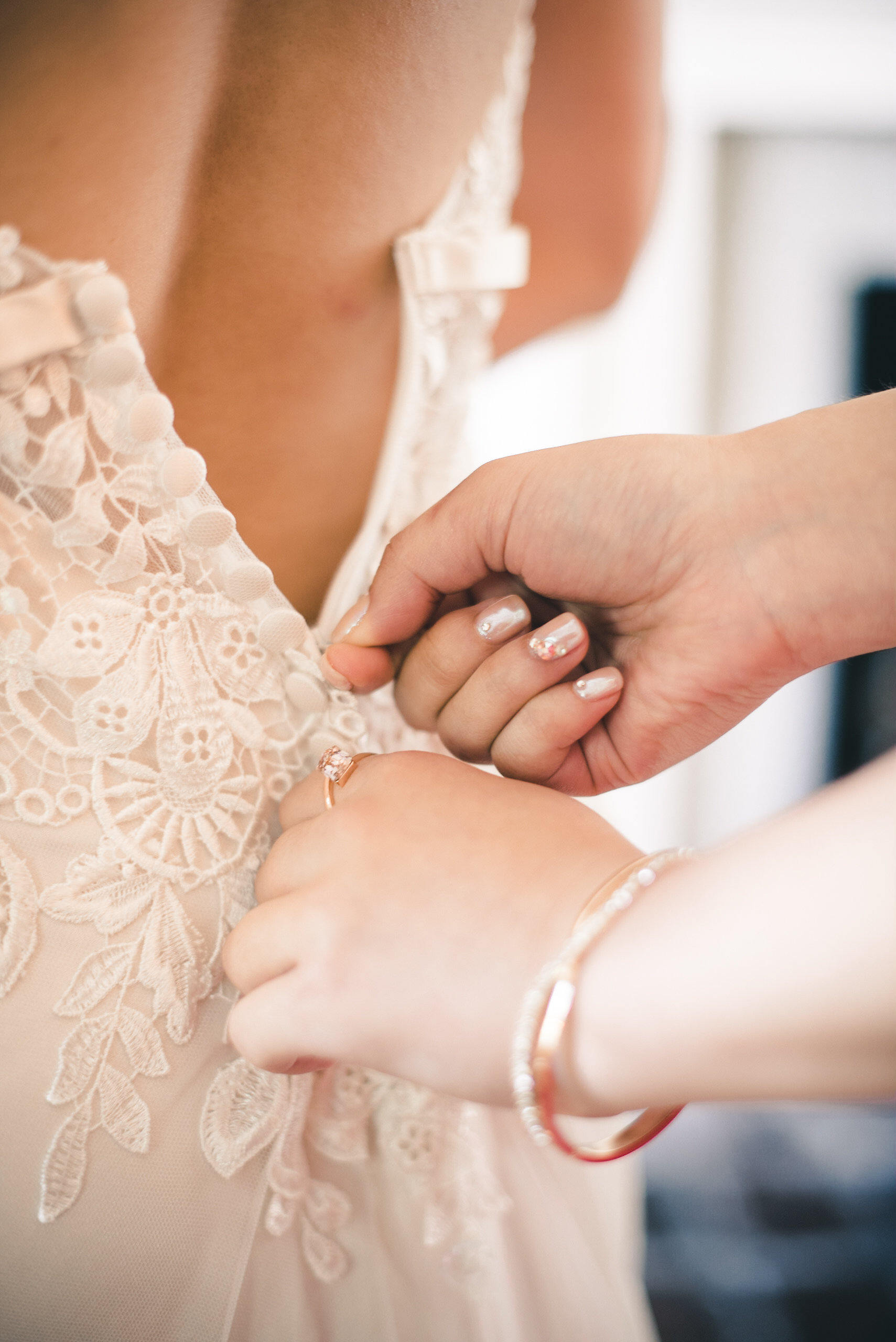 Buttoning up bridal dress