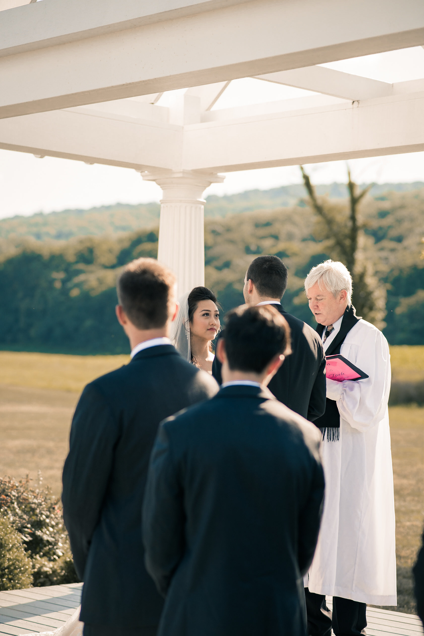 Bride and groomsmen during ceremony