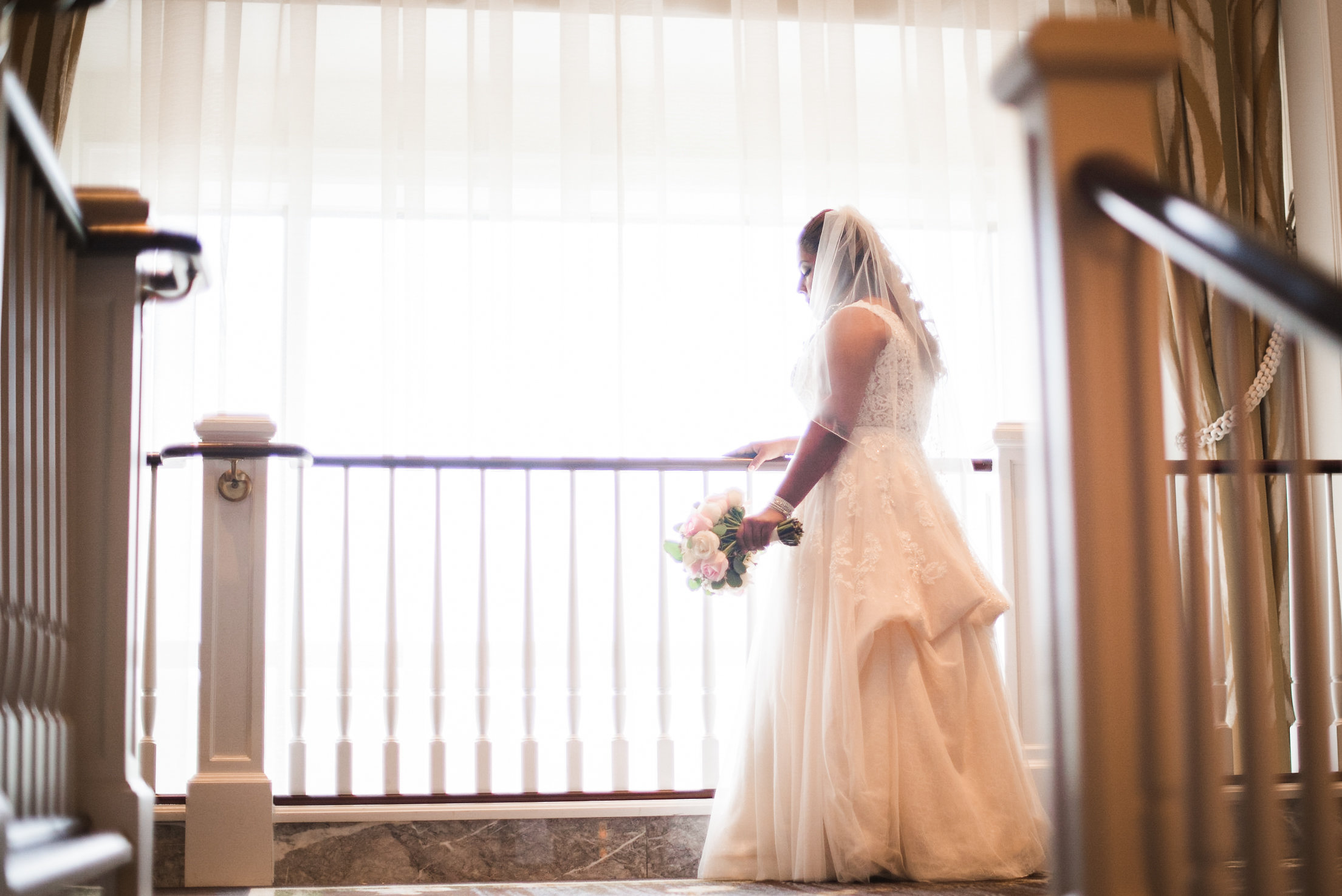 Bride standing at top of stairs