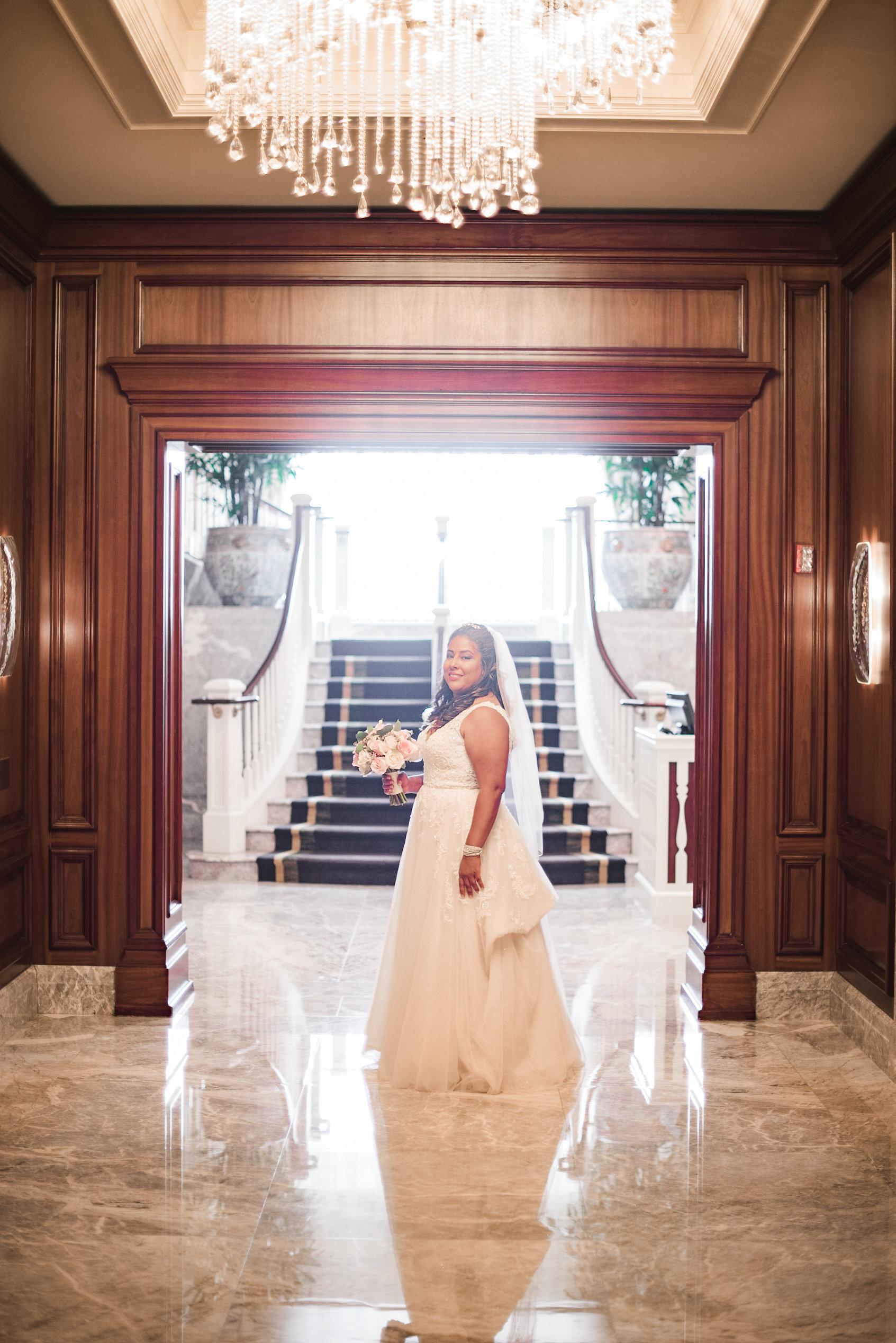 Bride standing in long hallway