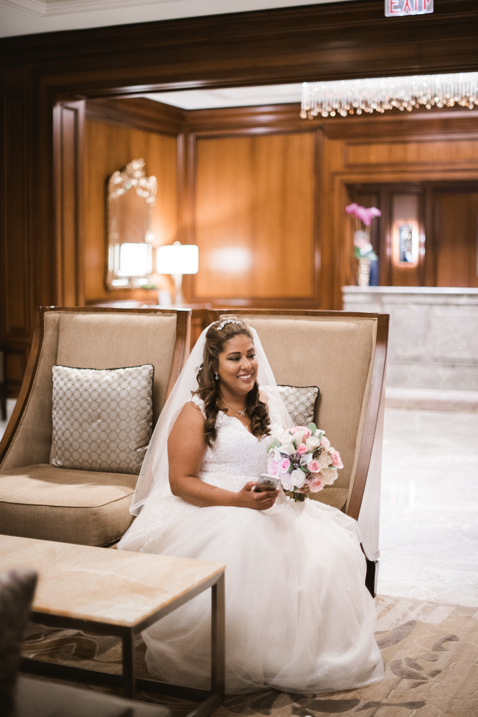 Bride sitting on couch in hotel