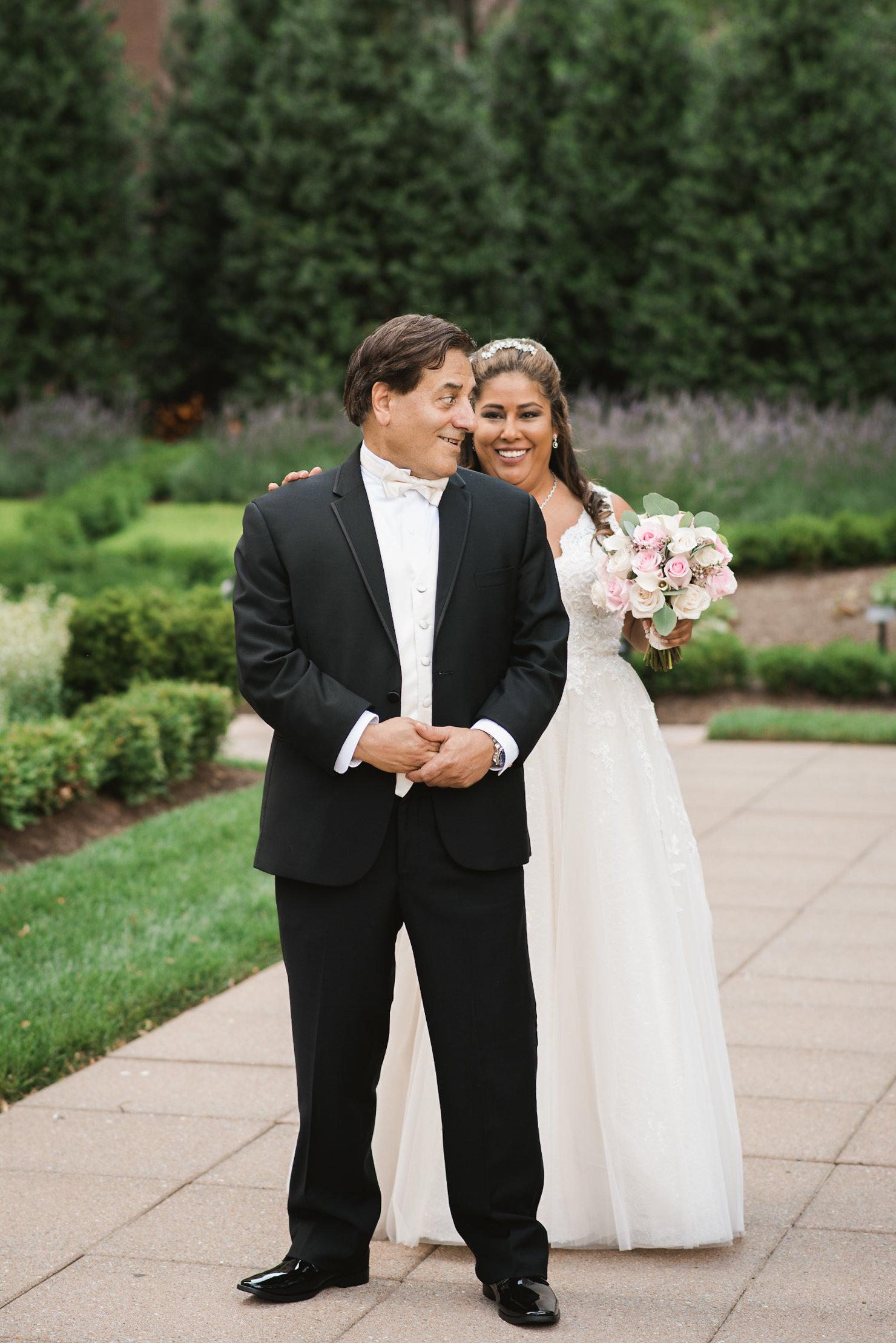 Groom looking over shoulder at bride