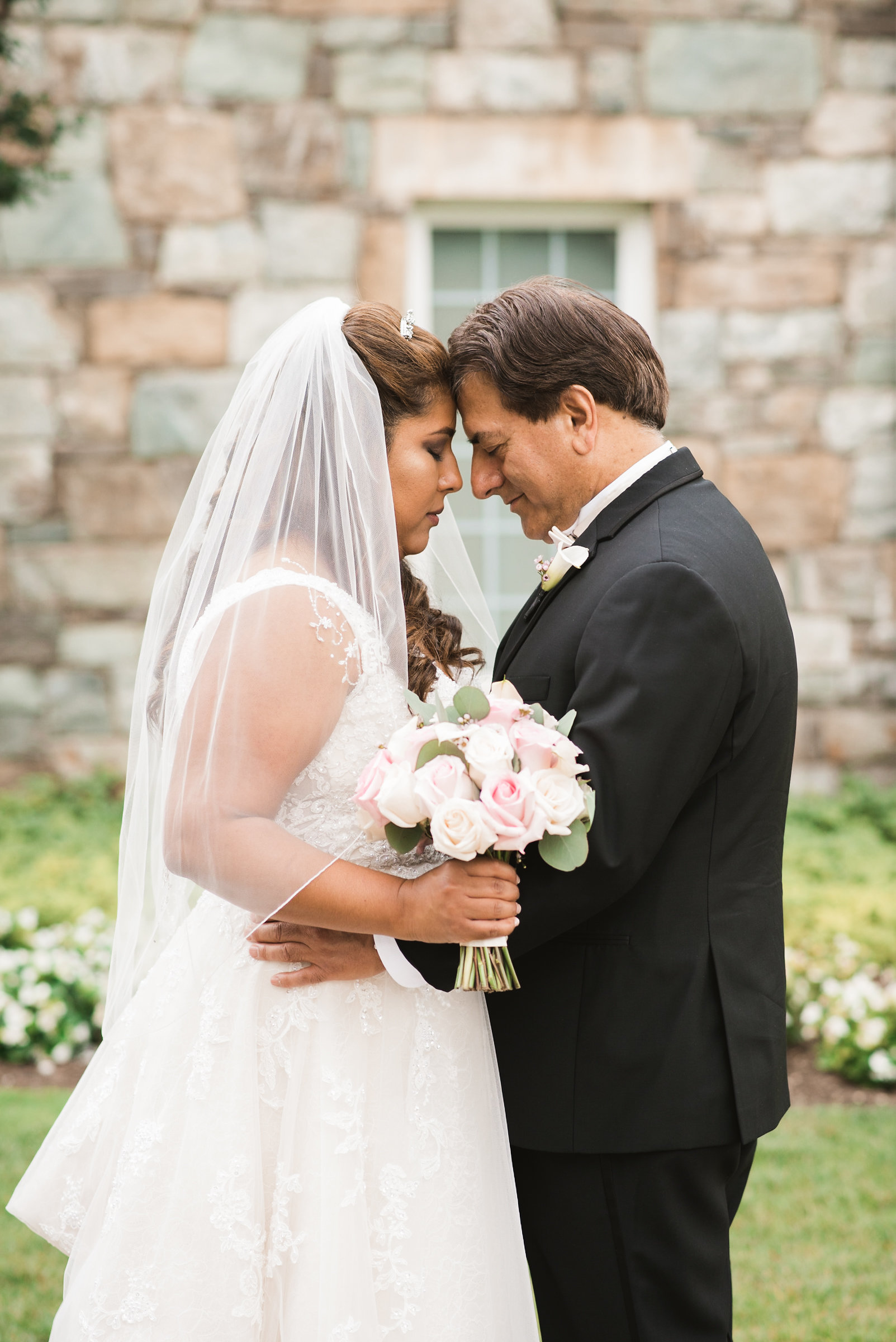 Bride and groom heads touching