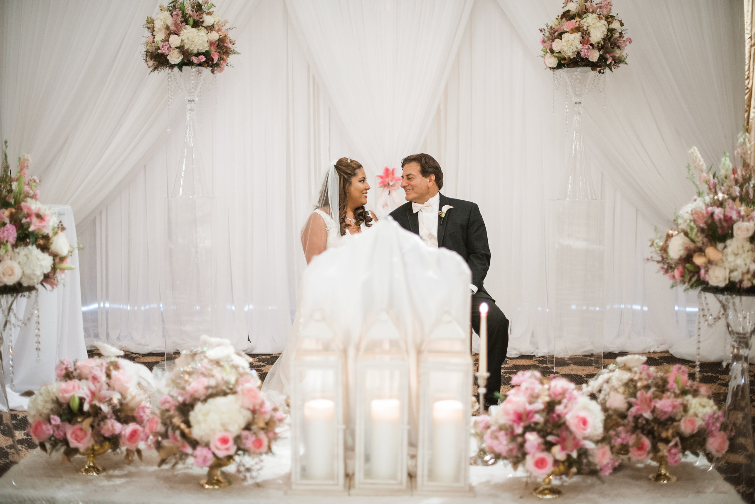 Bride and groom sitting at altar