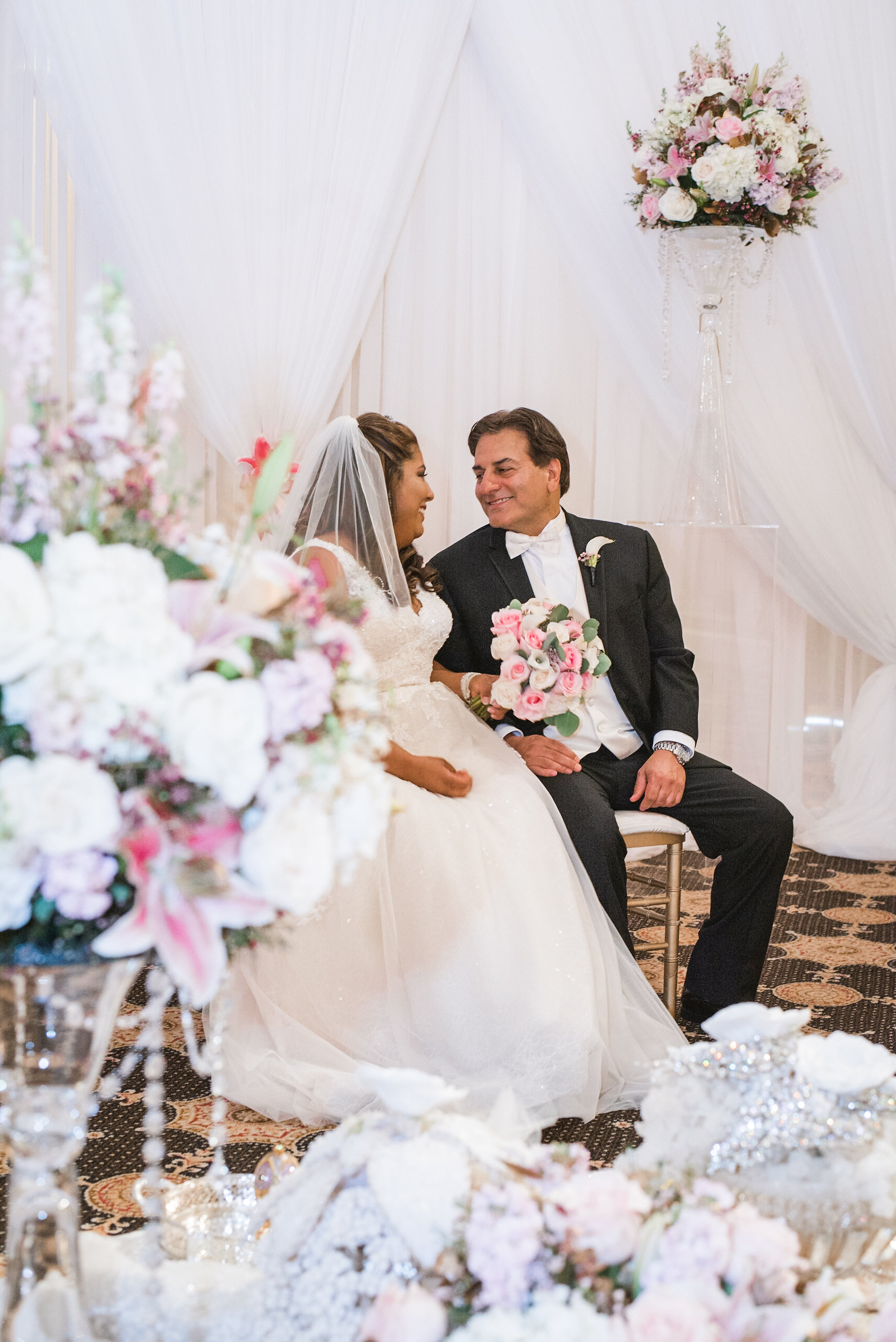 Bride and groom sitting in ceremony space