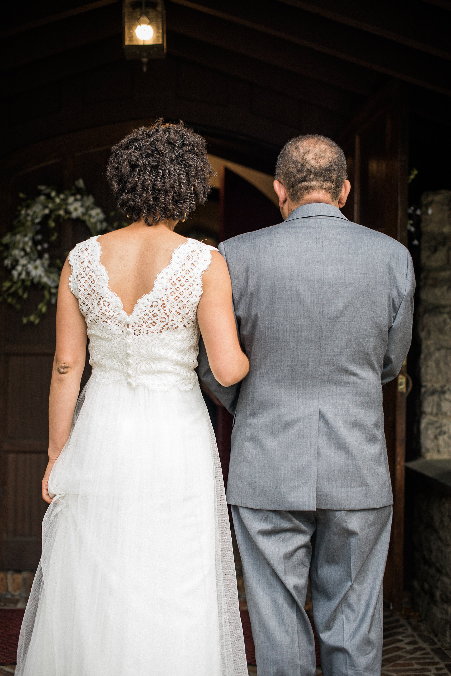 Father and bride seen from behind
