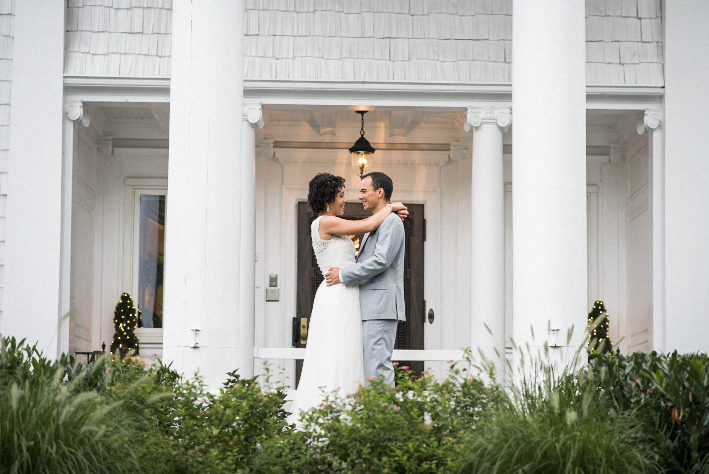 Bride and groom standing between columns