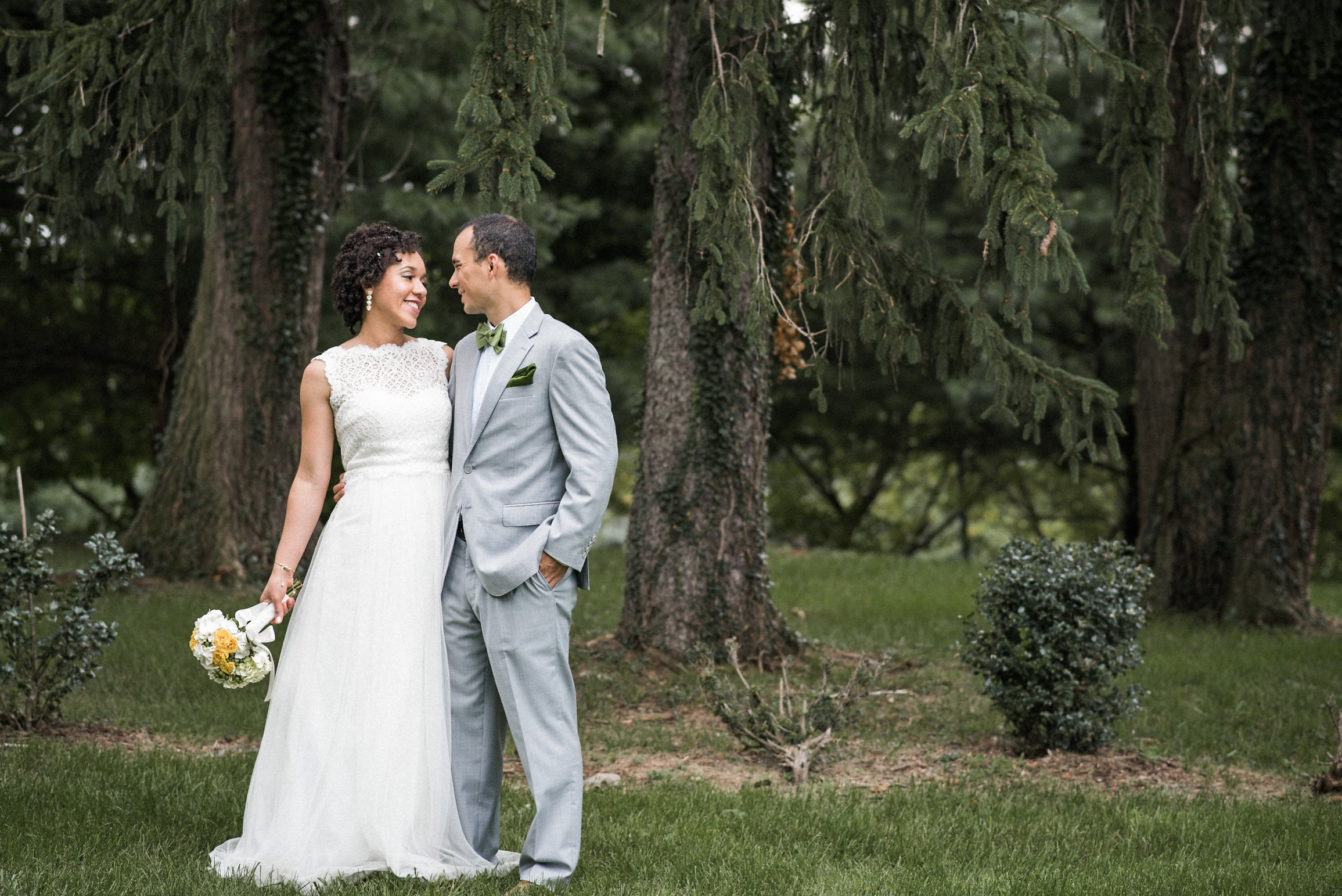 Bride and groom in forest setting